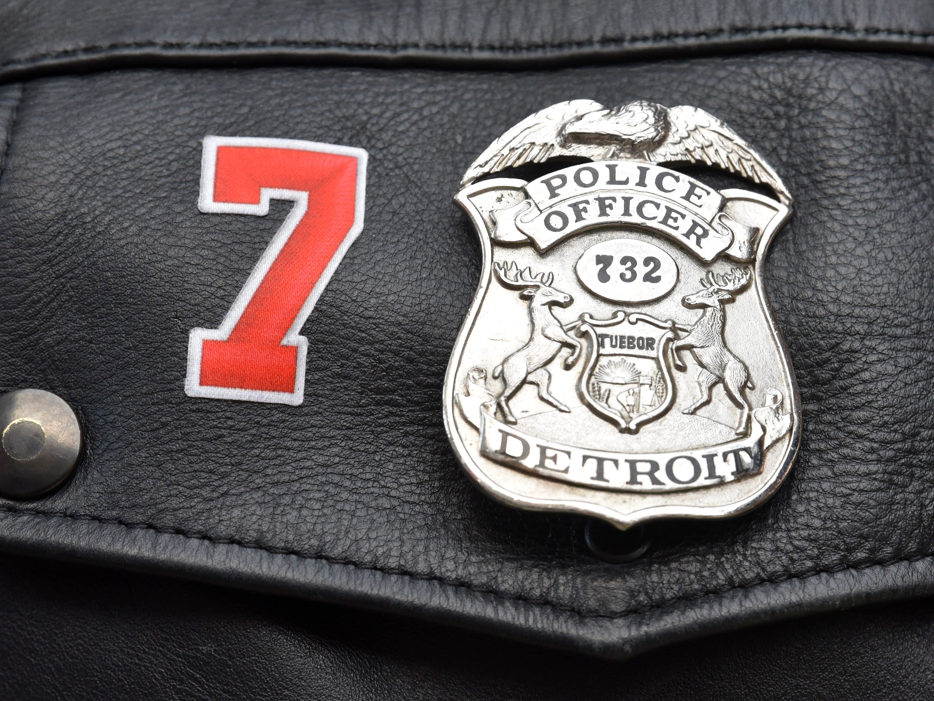 Detroit Police Officer Chris Meredyk wears Ted Lindsay's #7 near his badge as he works the event. Meredyk is captain of the Detroit Police Hockey Team.