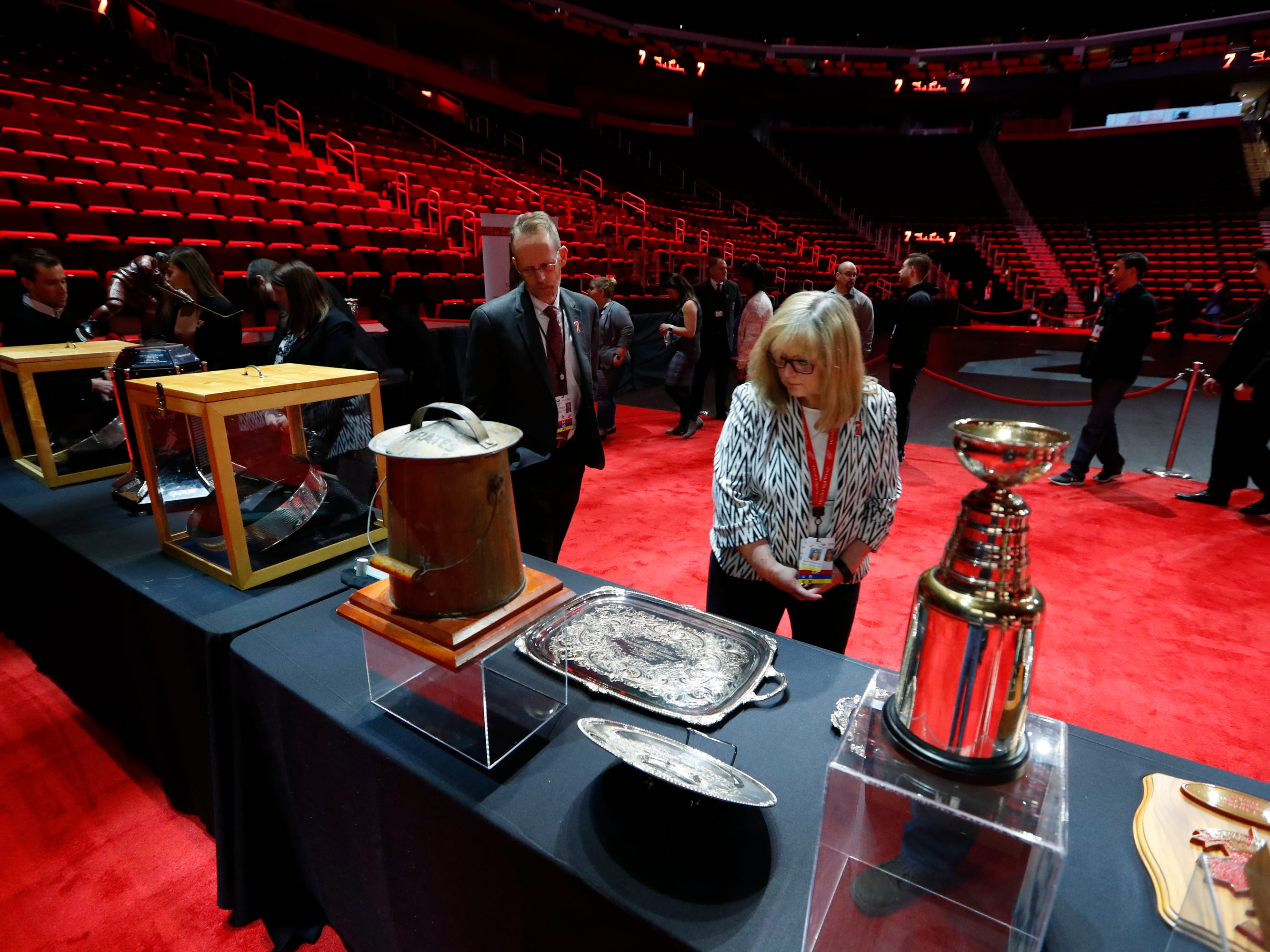 Mourners view memorabilia at the public viewing of former Detroit Red Wings player Ted Lindsay.