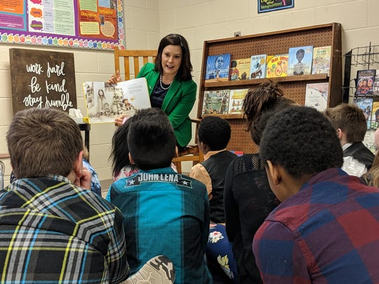 Michigan Gov. Gretchen Whitmer reads to students Friday at Northeast Elementary School in Jackson.