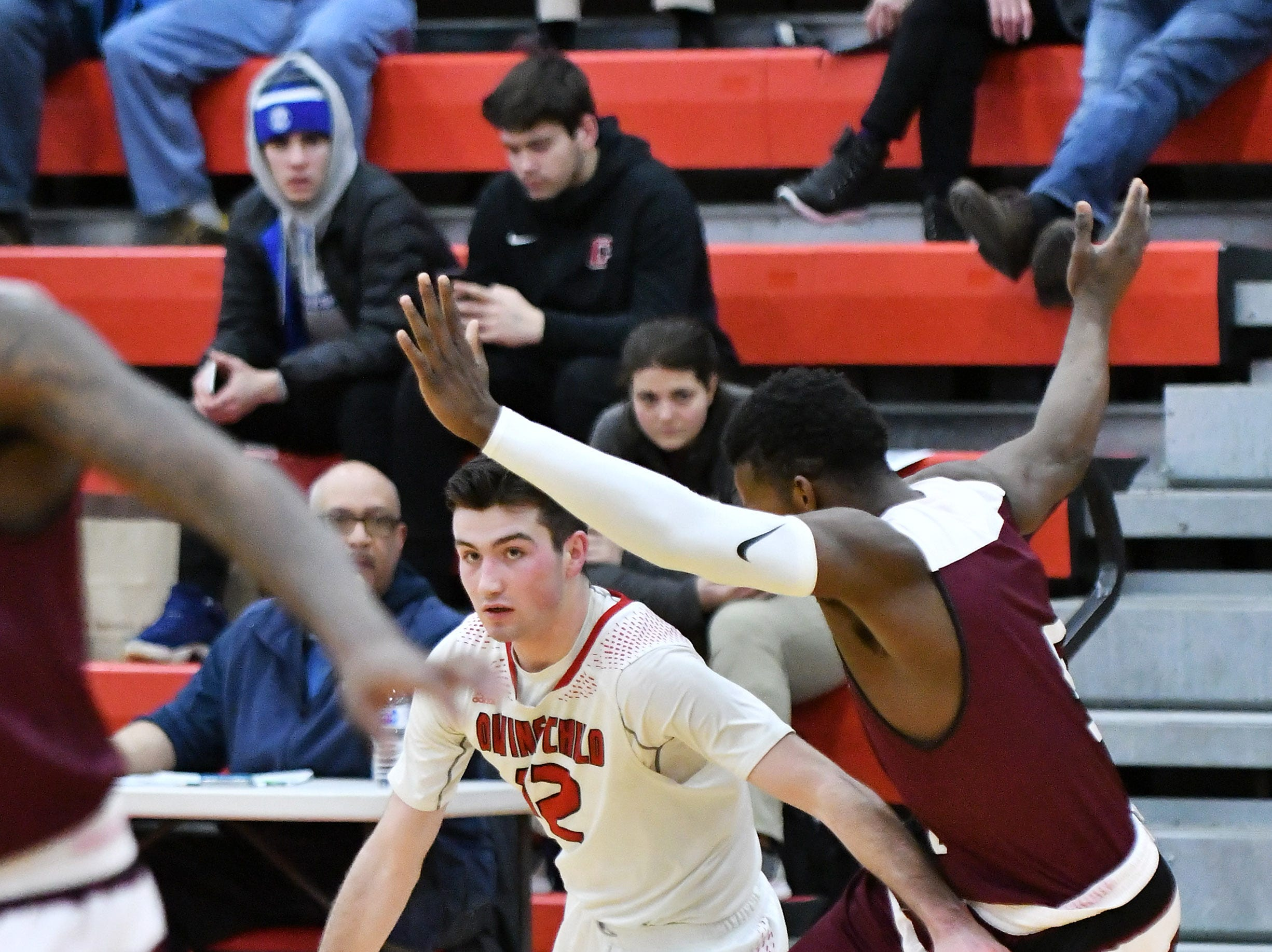 River Rouge's Jason Norton guards Divine Child's Jack Kenney (12) in the second half.