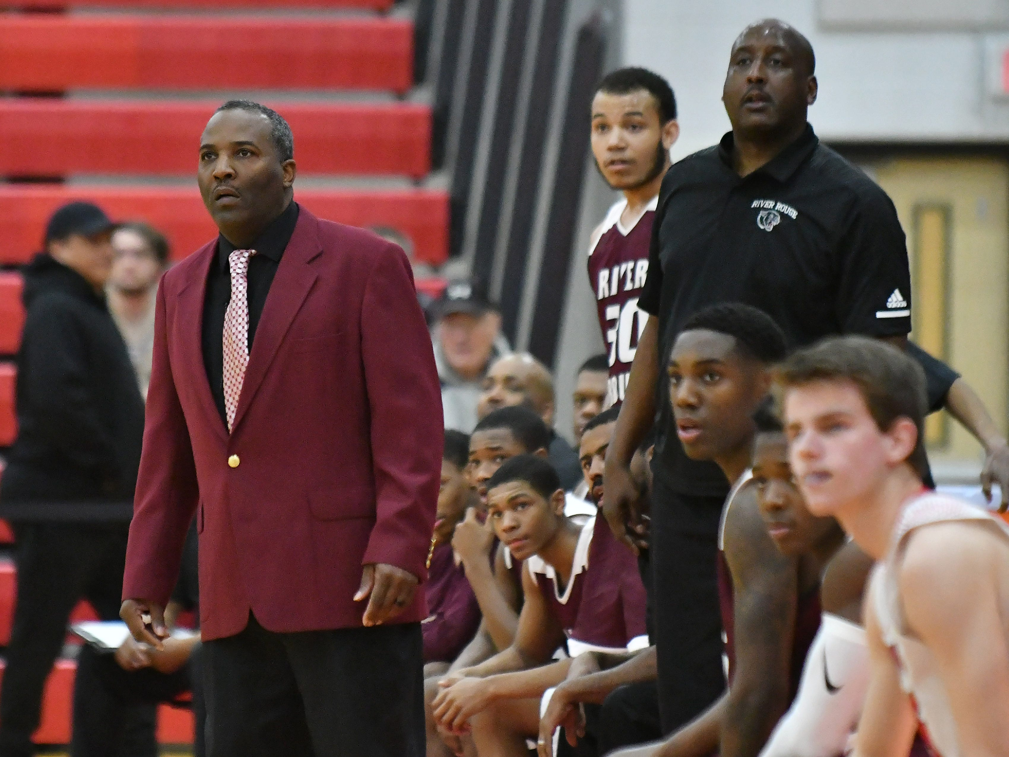 River Rouge head coach LaMonte Stone, left, watches in the first half.