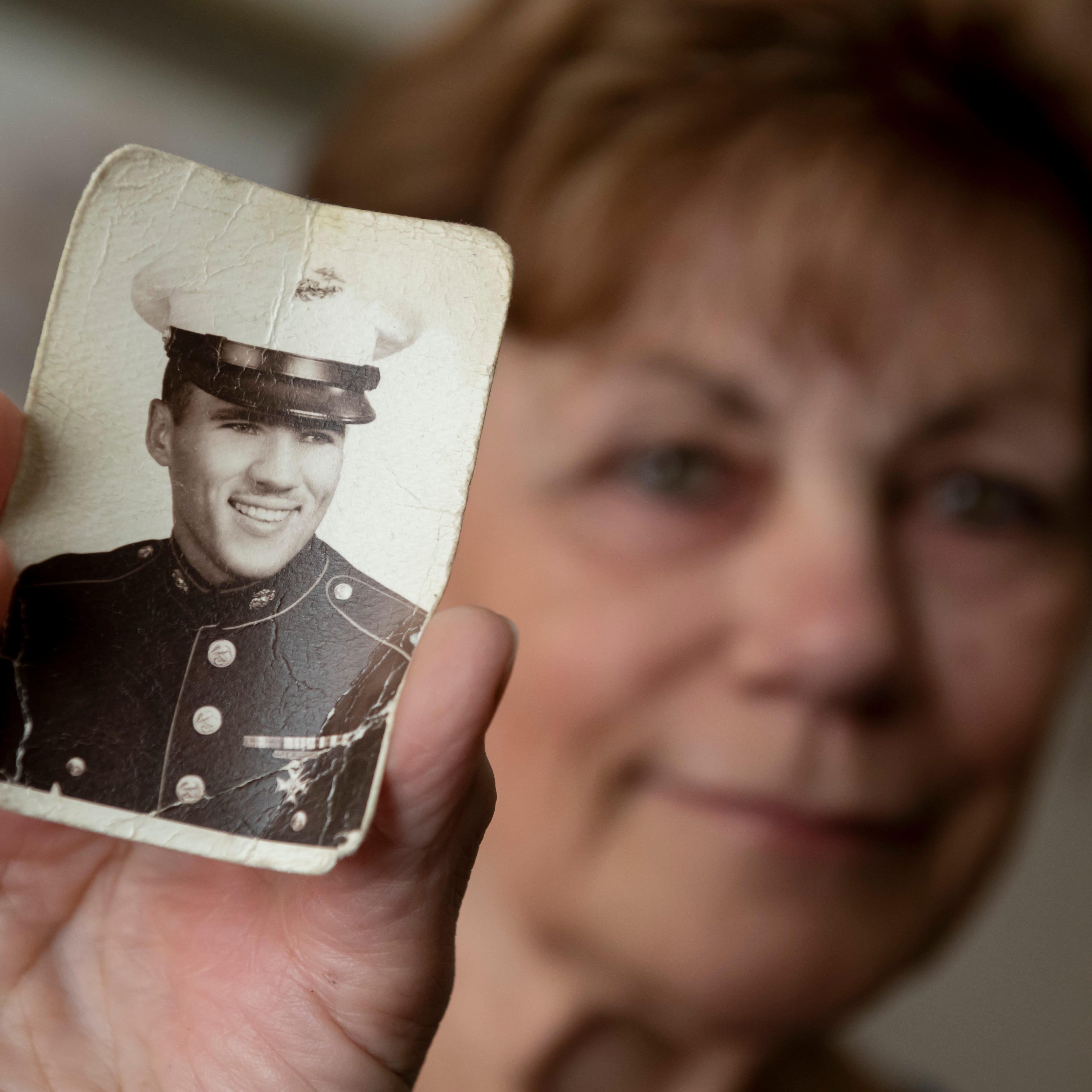 Never forgotten: Volunteers match faces to names of Vietnam War dead