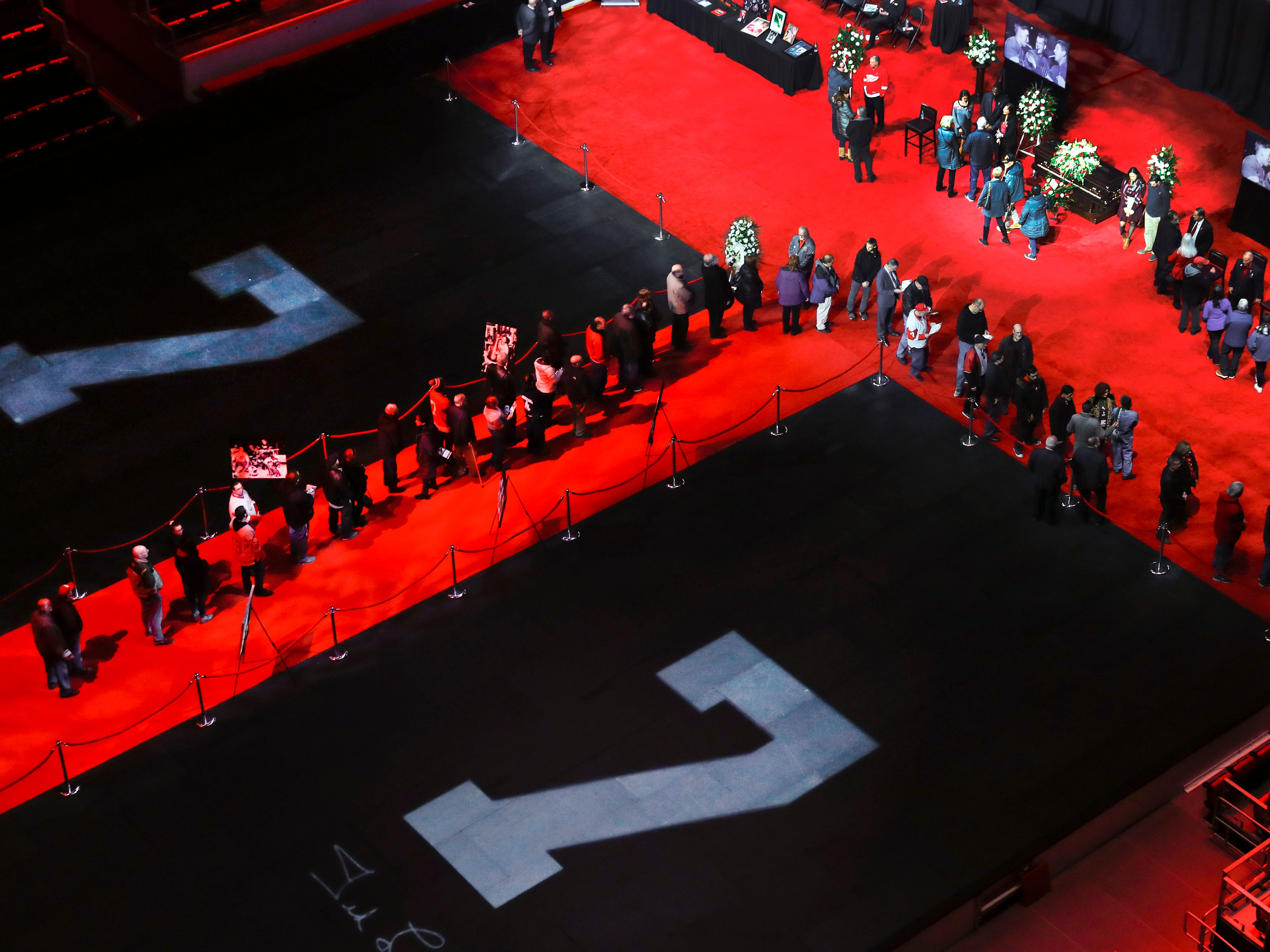 The line to the casket of former Detroit Red Wings player Ted Lindsay snakes around his No. 7s on the floor at Little Caesars Arena in Detroit Friday afternoon, March 8, 2019.  The Hall of Famer and Red Wings legend died Monday at the age of 93.