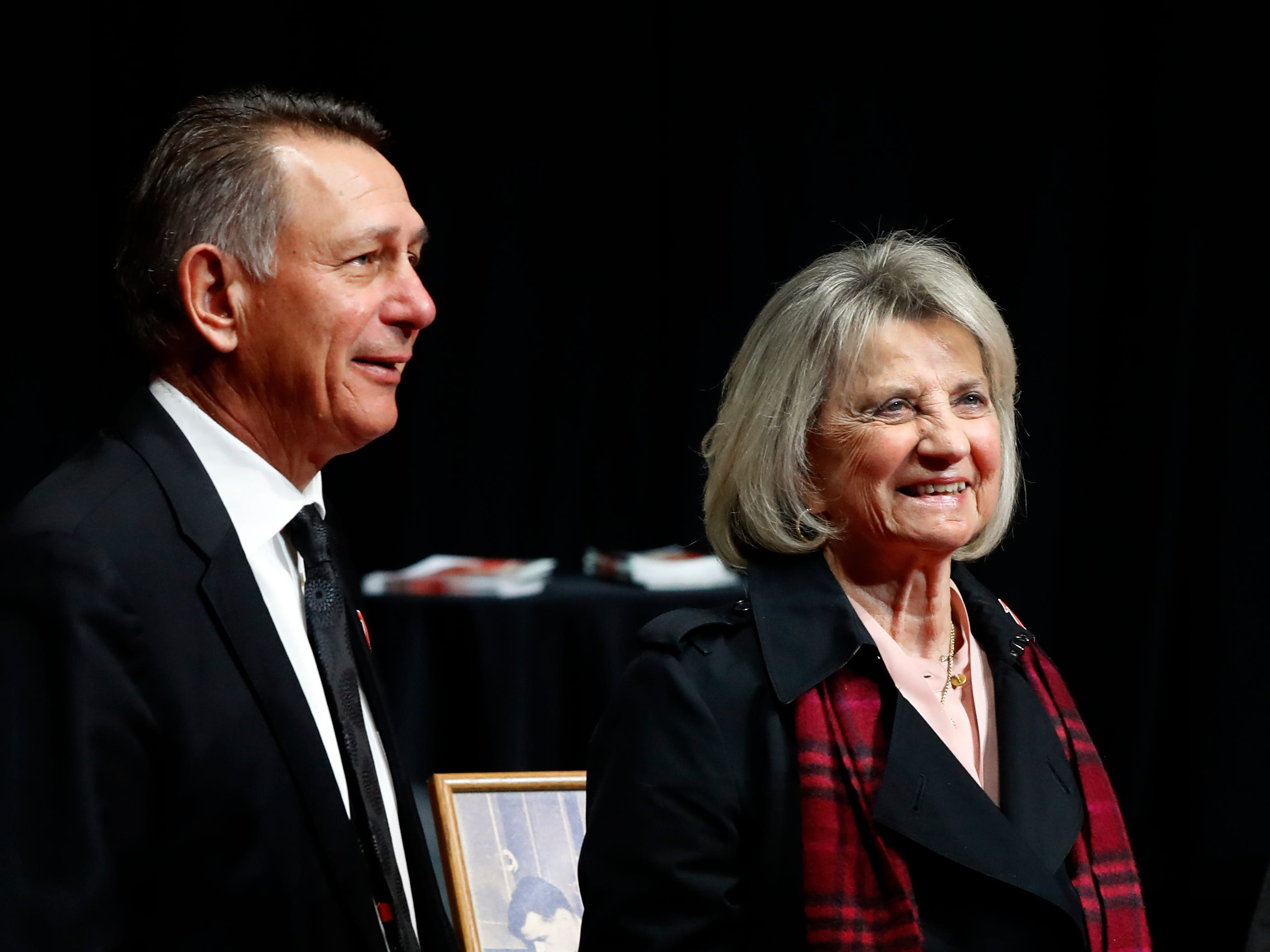 Detroit Red Wings owner Marian Ilitch, right, and team general manager Ken Holland appear at the public viewing of  Ted Lindsay, Friday, March 8, 2019, in Detroit. Lindsay.