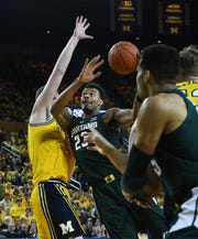 Xavier Tillman drives to the basket in the first half of MSU's win over Michigan on Feb. 24.