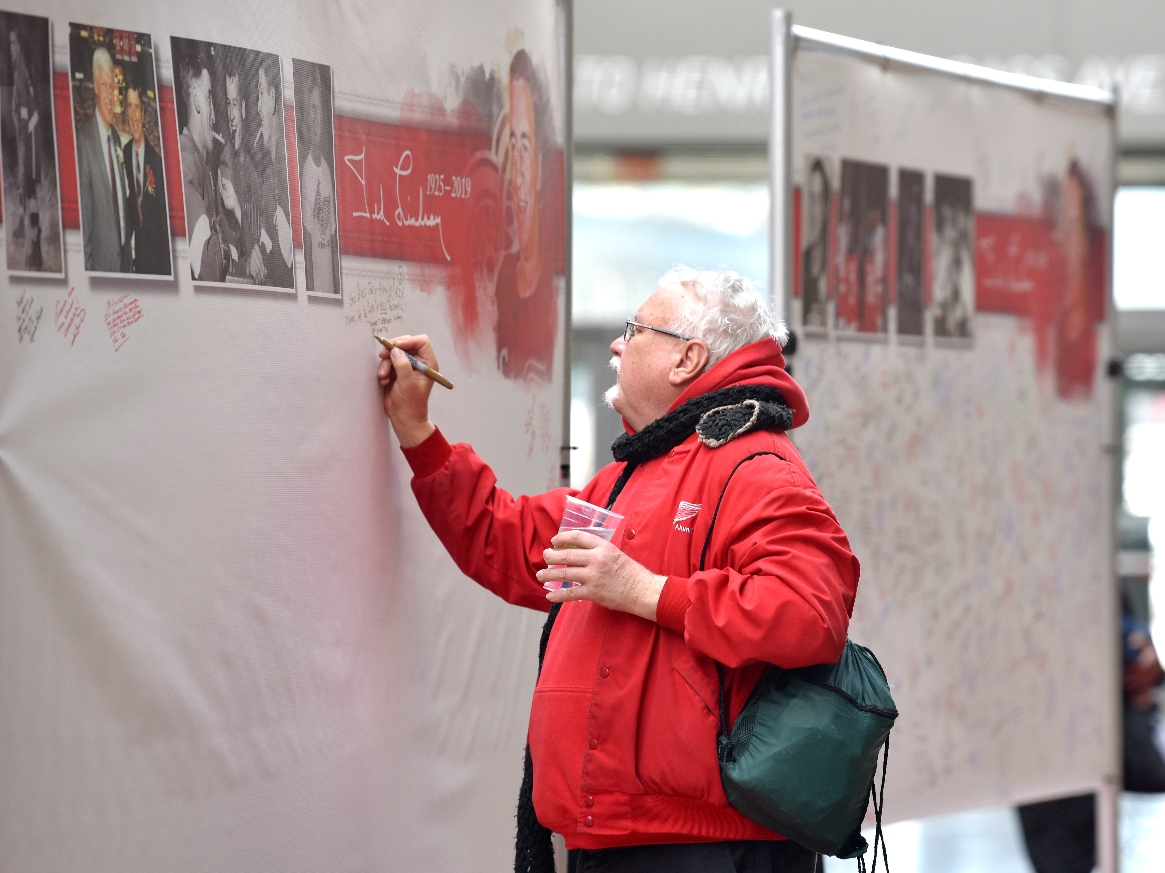 Great Lakes Lights owner Leonard T. Zabawski, a visual artist from Canton, leaves a comment on one of three boards in The Via at Little Caesars Arena.