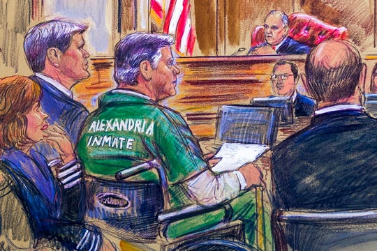 This courtroom sketch depicts former Trump campaign chairman Paul Manafort, center in a wheelchair, during his sentencing hearing in federal court before judge T.S. Ellis III in Alexandria, Va., Thursday, March 7, 2019.