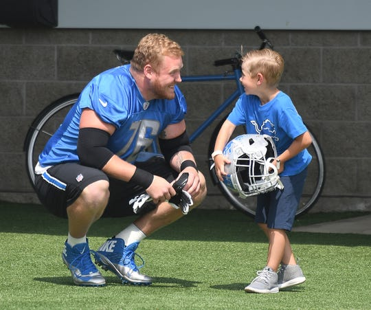 T.J. Lang with son J.J. Lang during Lions training camp in 2017.
