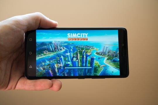 """Playing """"SimCity,"""" Jason Baker said, """"helped remind me of the importance of local government, which is what I ended up doing for a living."""" (Ksinan Peter/Dreamstime/TNS)"""