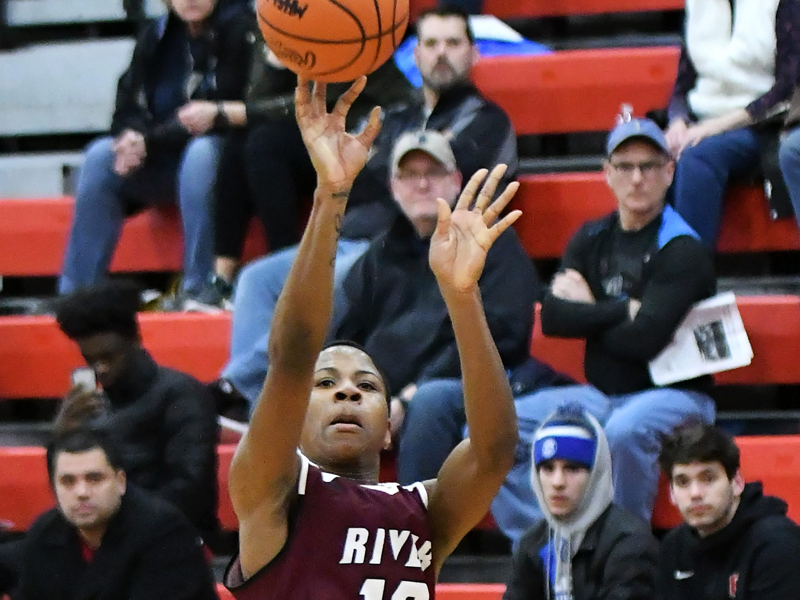River Rouge's Bralin Toney takes a wide open shot in the first half.