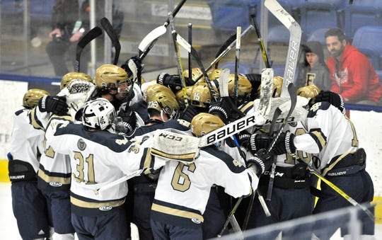 Country Day celebrates a 3-1 victory over East Grand Rapids in a Division 3 state semifinal in Plymouth on Friday.