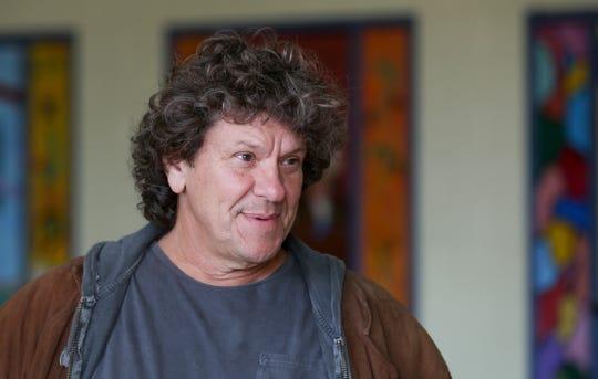 Woodstock co-founder Michael Lang speaks during a tour at the former Zena Elementary School in Woodstock, N.Y.