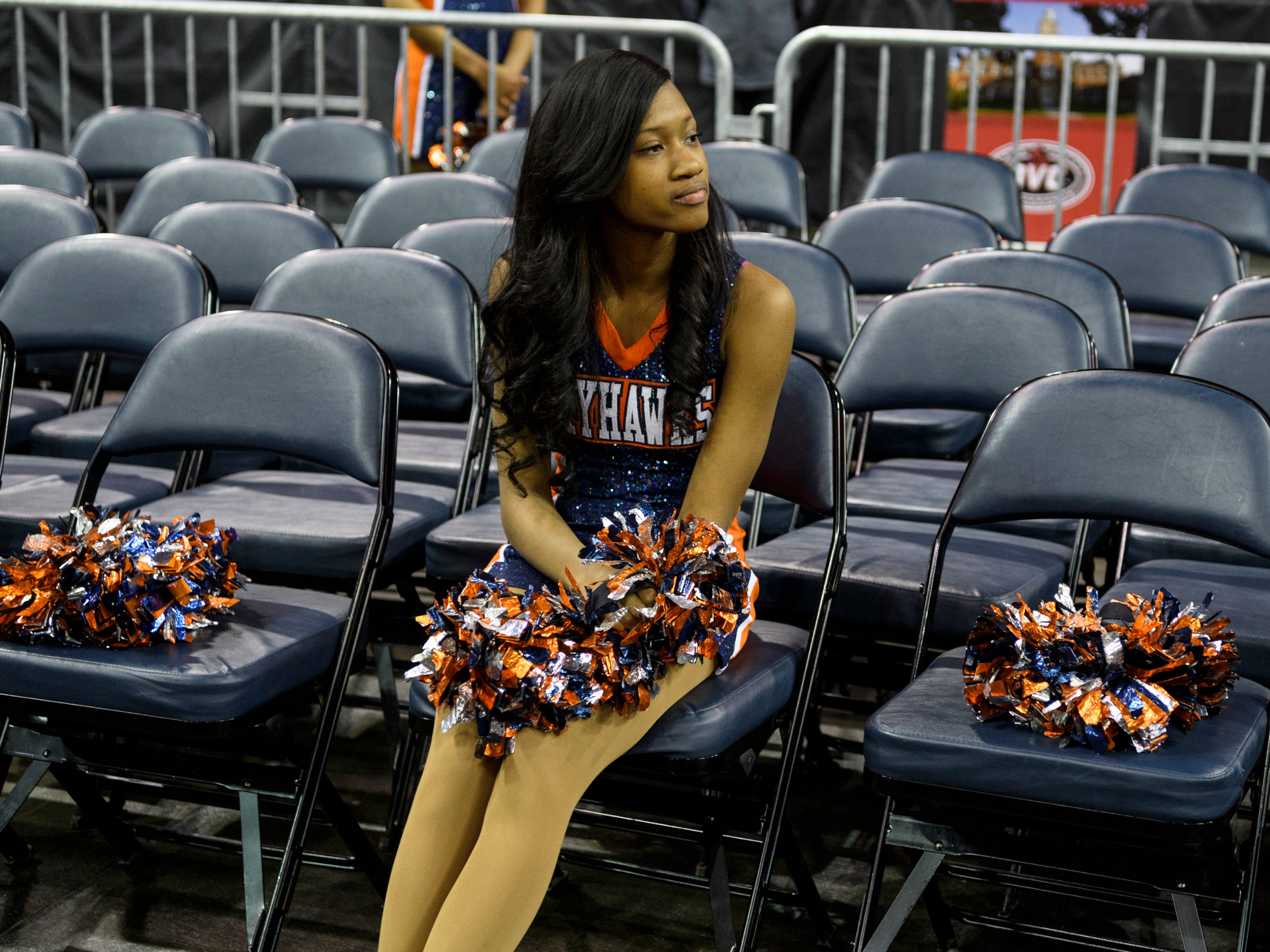Jamesha Shelton, a member of the University of Tennessee Martin dance team, takes a moment to relax as she watches the women's basketball game against Murray State at the Ohio Valley Conference tournament in Evansville's Ford Center, Thursday, March 7, 2019.