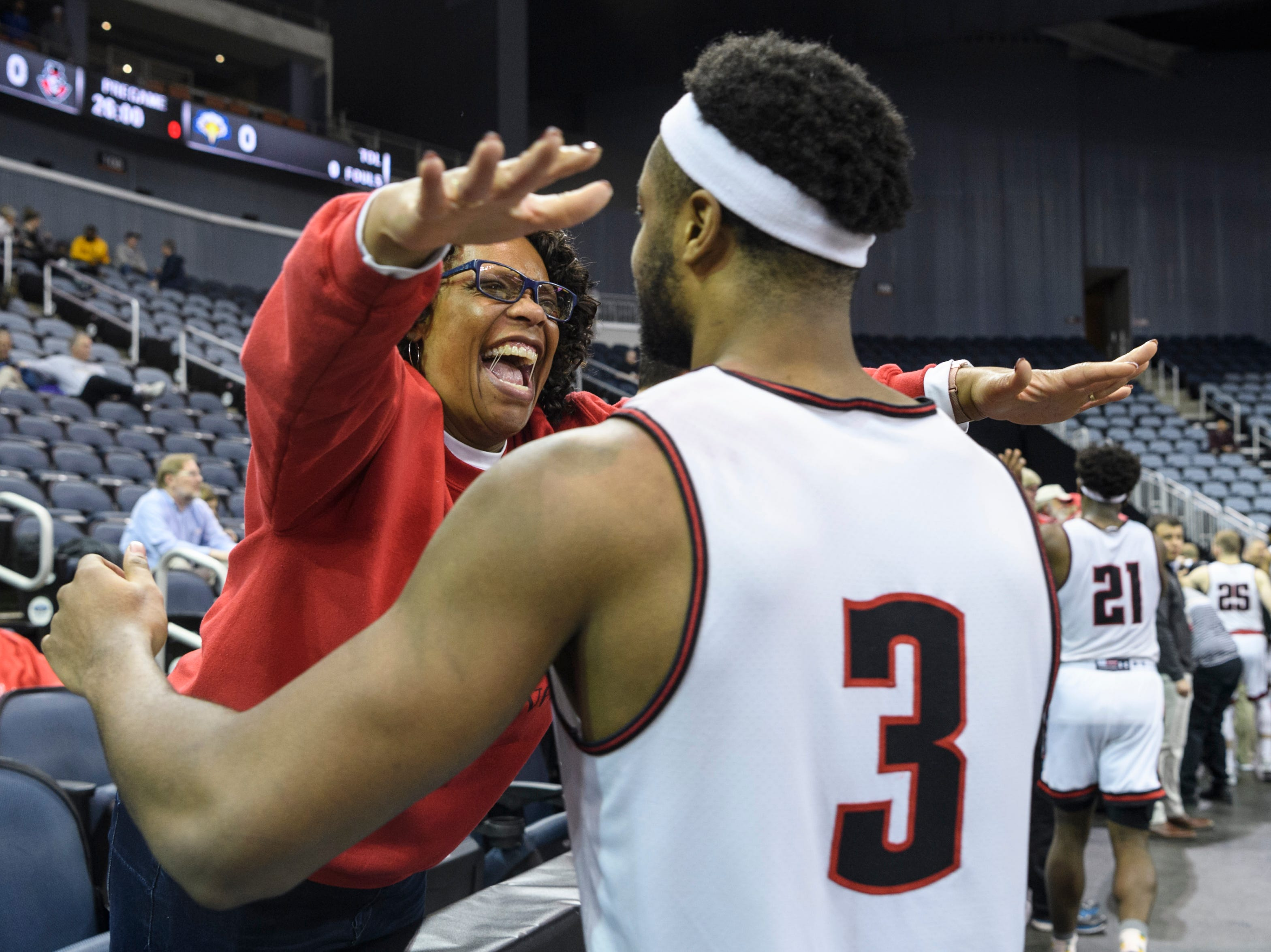 Cheryl Bunton embraces Austin Peay's Chris Porter-Bunton (3) as they celebrate the Governors' 91-85 victory over the Morehead State University Eagles in the Ohio Valley Conference tournament quarterfinals at Ford Center in Evansville, Ind., Thursday, March 7, 2019.
