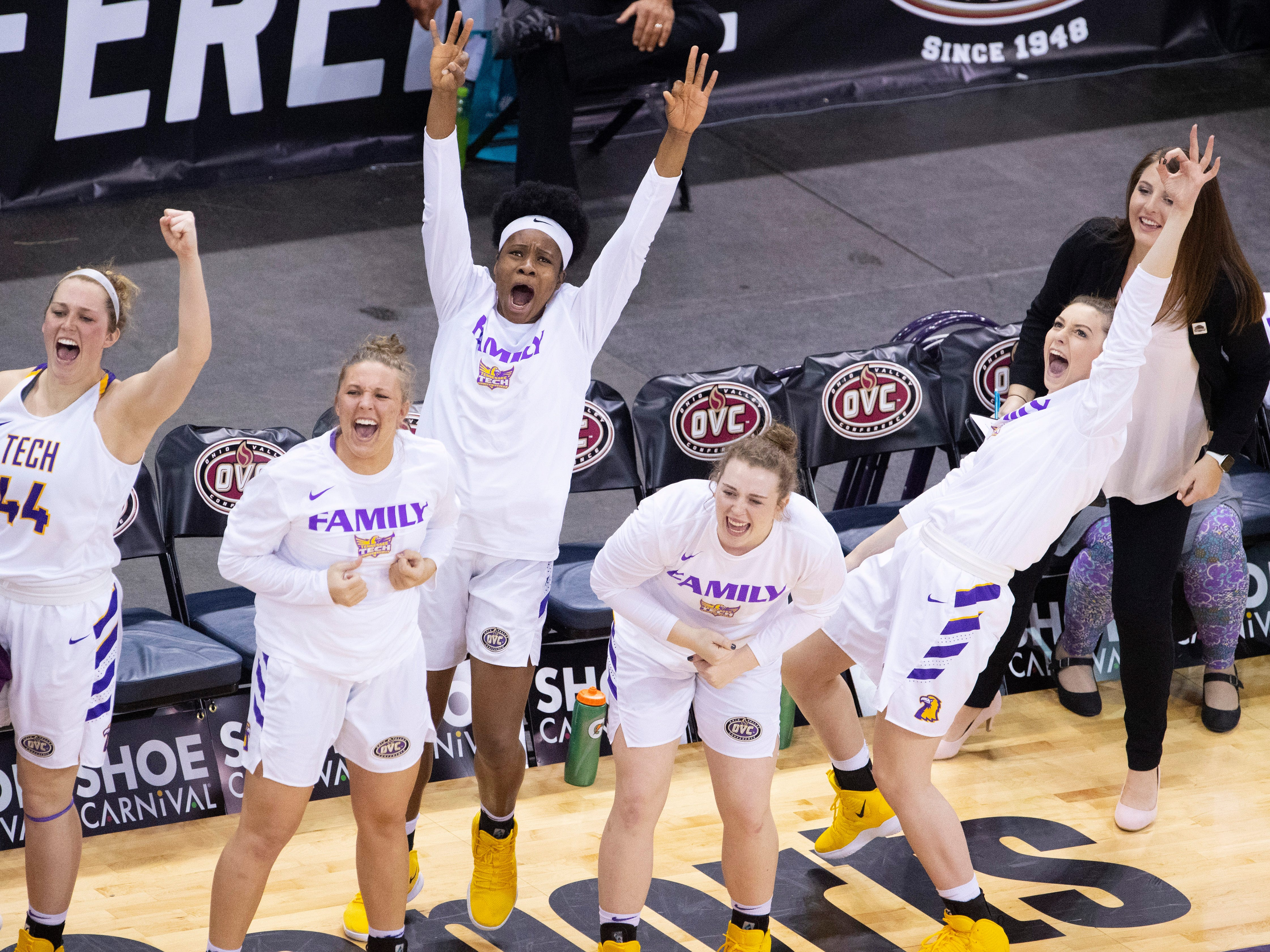 Tennessee Tech's bench erupts after scoring a three-pointer against Austin Peay during their quarterfinal game of the Ohio Valley Conference Women's Basketball Championship at the Ford Center Thursday afternoon. Tennessee Tech came out on top and advanced to Friday's semifinal game.