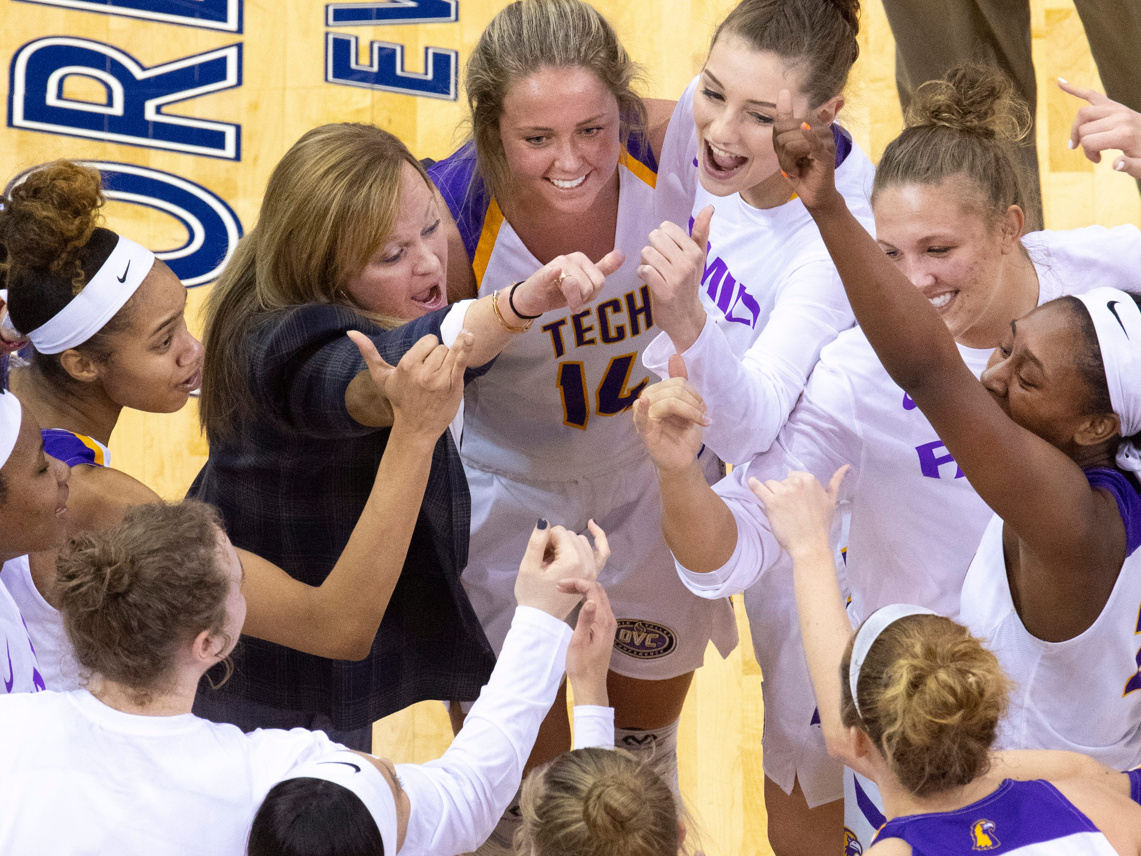 Tennessee Tech celebrates their win over Austin Peay after their quarterfinal game of the Ohio Valley Conference Women's Basketball Championship at the Ford Center Thursday afternoon. Tennessee Tech came out on top and advanced to Friday's semifinal game.