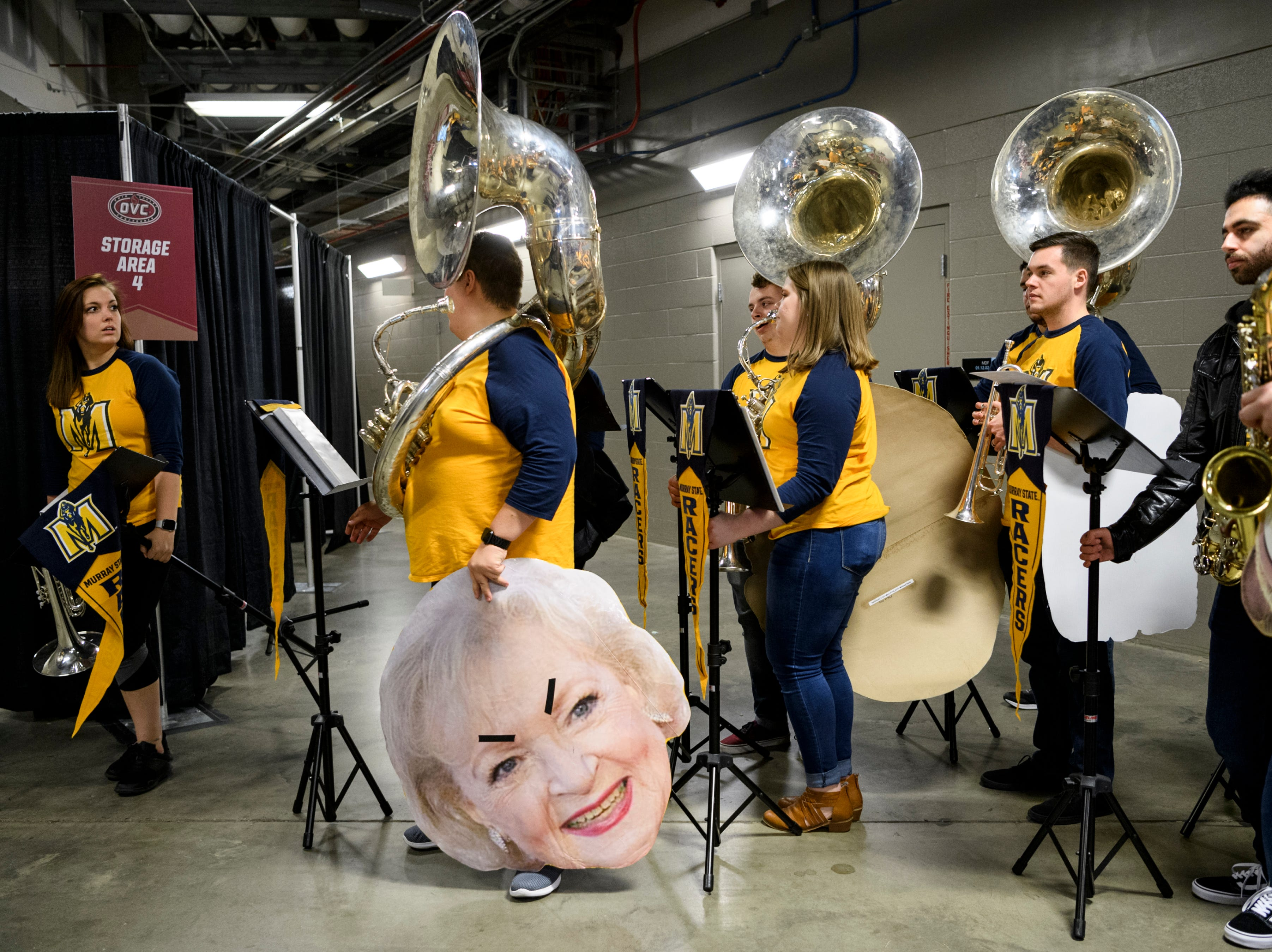 Members of the Murray State Racer pep band prepare to walk into the arena to set up before their women's basketball team plays the University of Tennessee Martin at Ford Center in Evansville, Ind., Thursday, March 7, 2019.