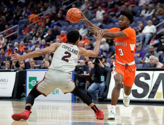 Evansville's Jawaun Newton (3) passes the ball past Illinois State's Zach Copeland (2) during the first half of an NCAA college basketball game in the first round of the Missouri Valley Conference men's tournament Thursday, March 7, 2019, in St. Louis.
