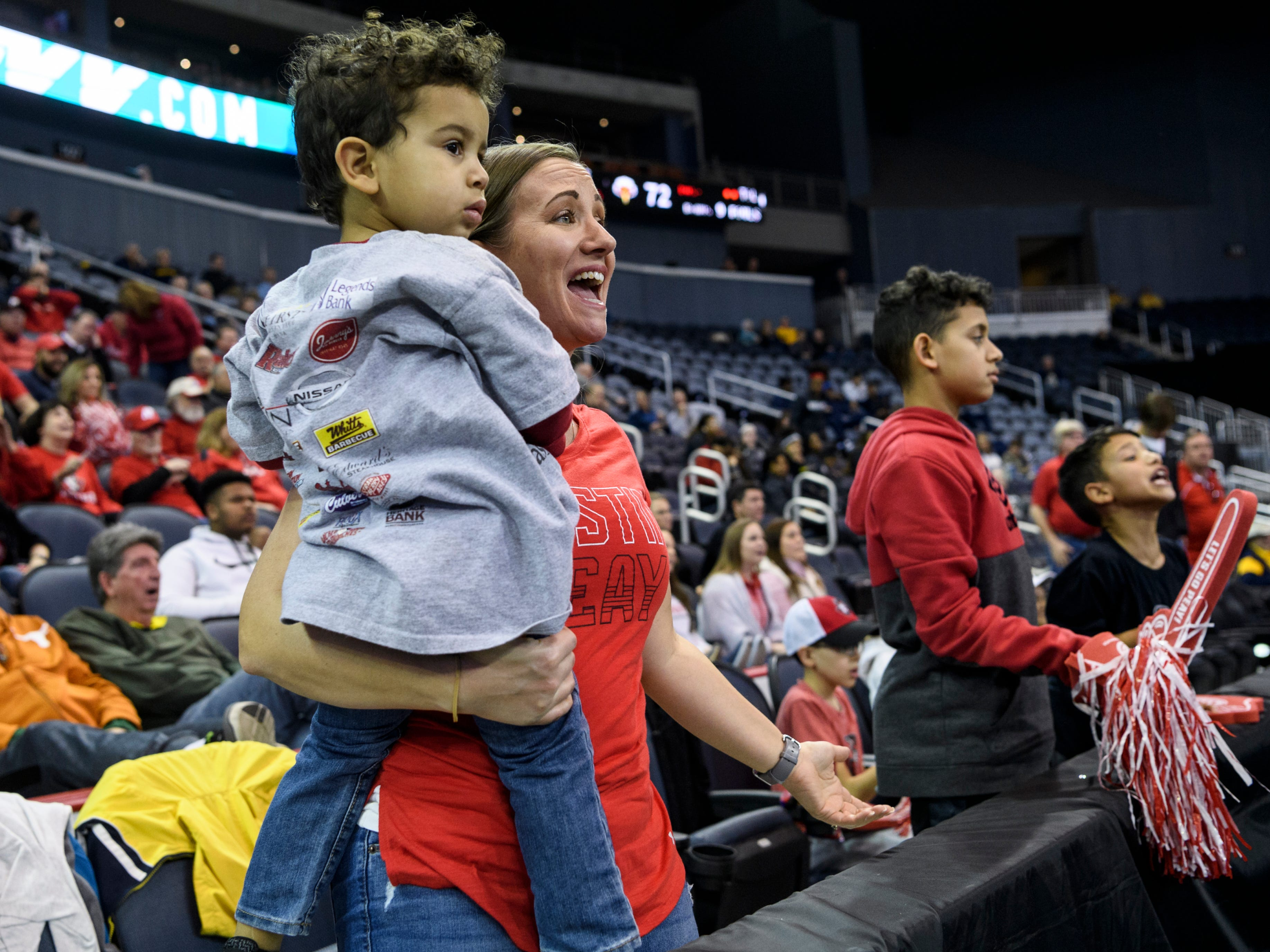 Danielle Cabrera voices her frustration with a foul call on the Austin Peay State University Governors while watching the game with her sons Landon, 3, Jayden, 12, and Braxton, 9, during the Ohio Valley Conference tournament quarterfinals against the Morehead State Eagles at Ford Center in Evansville, Ind., Thursday, March 7, 2019. Danielle's husband Rick Cabrera works as an assistant coach for the Governors men's basketball team.