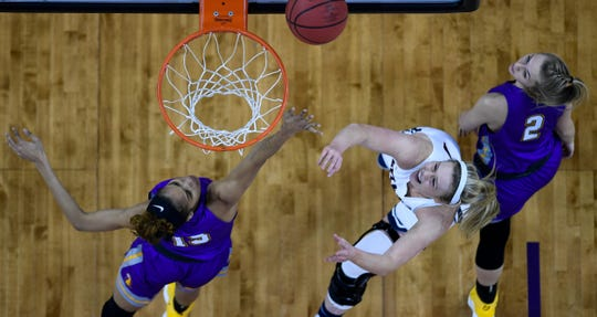 Belmont Bruins' Ellie Harmeyer (30) shoots over Tennessee Tech's Anacia Wilkinson (15) as the Belmont Bruins play the Tennessee Tech Golden Eagles in the Ohio Valley Conference semi-finals at the Evansville Ford Center Friday, March 8, 2019.