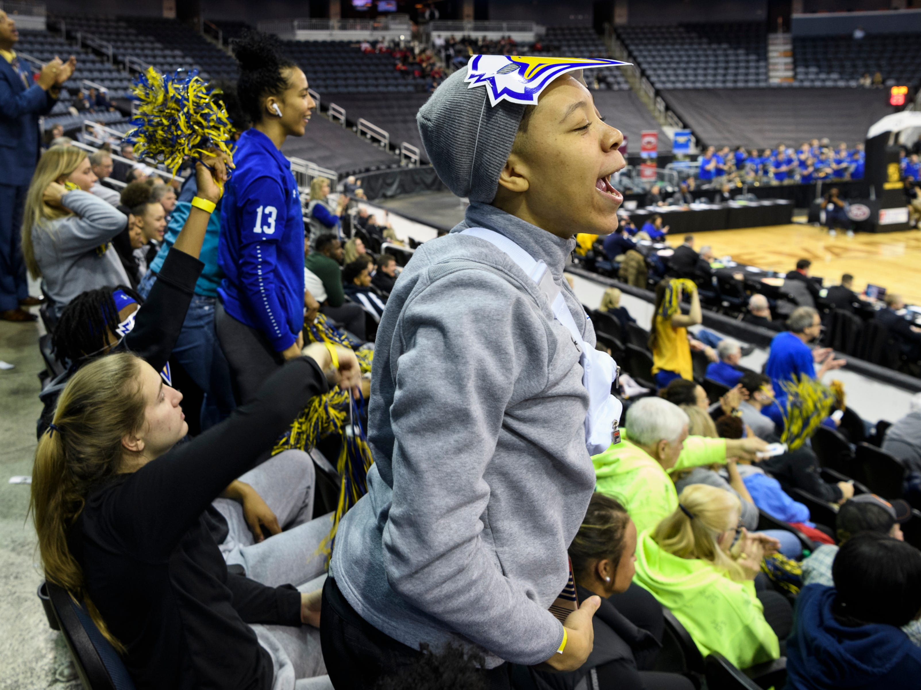 Miranda Crockett, a Morehead State University women's basketball player, cheers for the men's team as they take on the Austin Peay State University Governors during the Ohio Valley Conference tournament quarterfinals at Ford Center in Evansville, Ind., Thursday, March 7, 2019. The men's team was knocked out of the tournament on Thursday evening and the women's team was knocked out in the semifinals Friday.