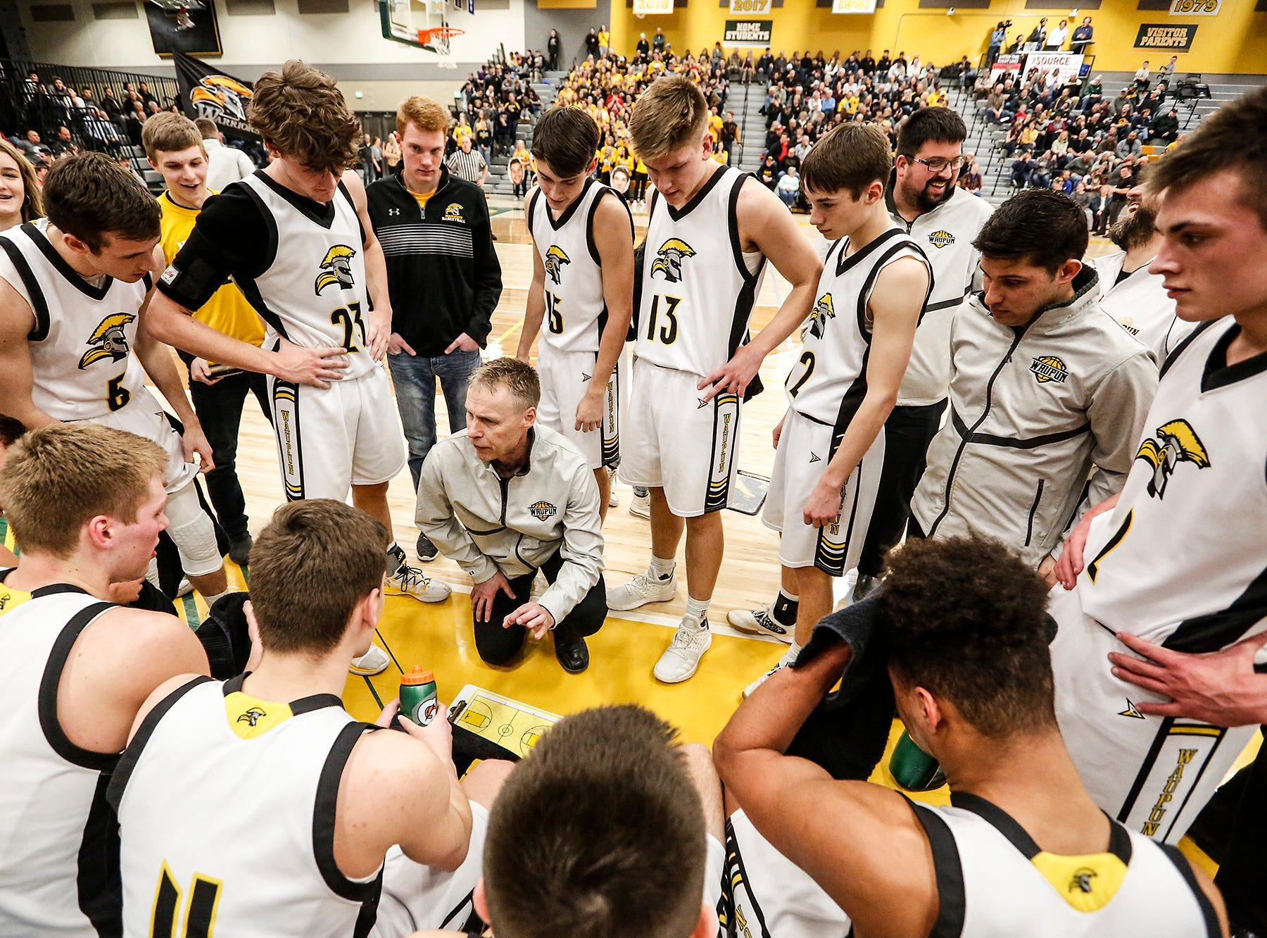 Waupun High School boys basketball's coach Dan Domask talks with his team during a time out during their WIAA division 3 sectional semi-final game against Columbus High School Thursday, March 7, 2019 in Beaver Dam, Wis. Waupun won the game 79-36. Doug Raflik/USA TODAY NETWORK-Wisconsin