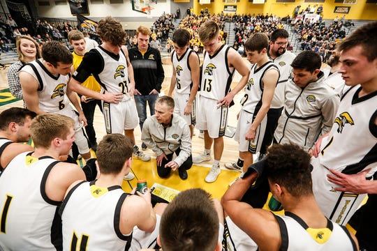 Waupun coach Dan Domask talks with his team during a timeout during a sectional semifinal game against Columbus on March 7 in Beaver Dam.