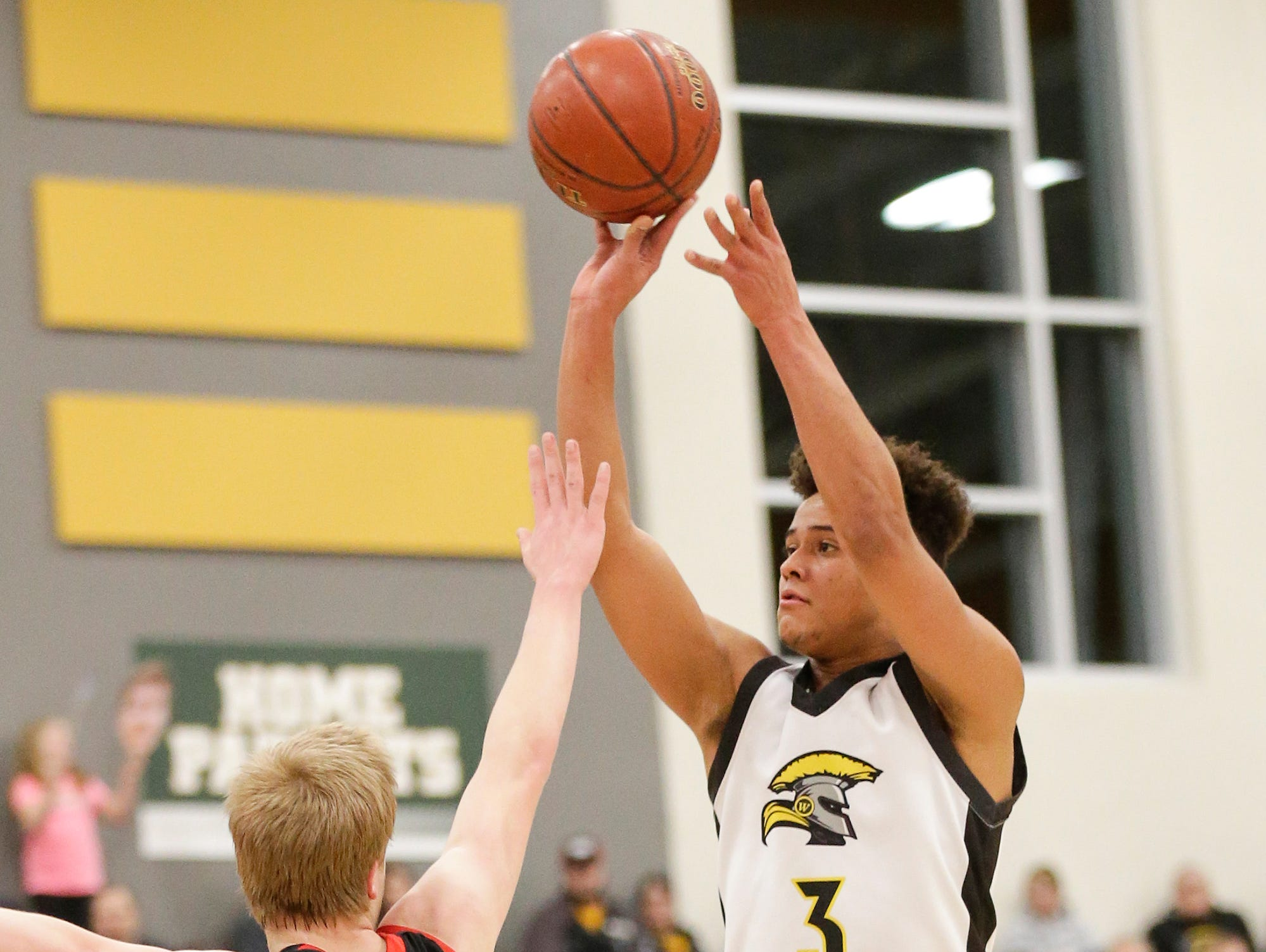 Waupun High School boys basketball's Quintin Winterfeldt goes up for a basket over Columbus High School's Sam Kahl during their WIAA division 3 sectional semi-final game Thursday, March 7, 2019 in Beaver Dam, Wis. Waupun won the game 79-36. Doug Raflik/USA TODAY NETWORK-Wisconsin