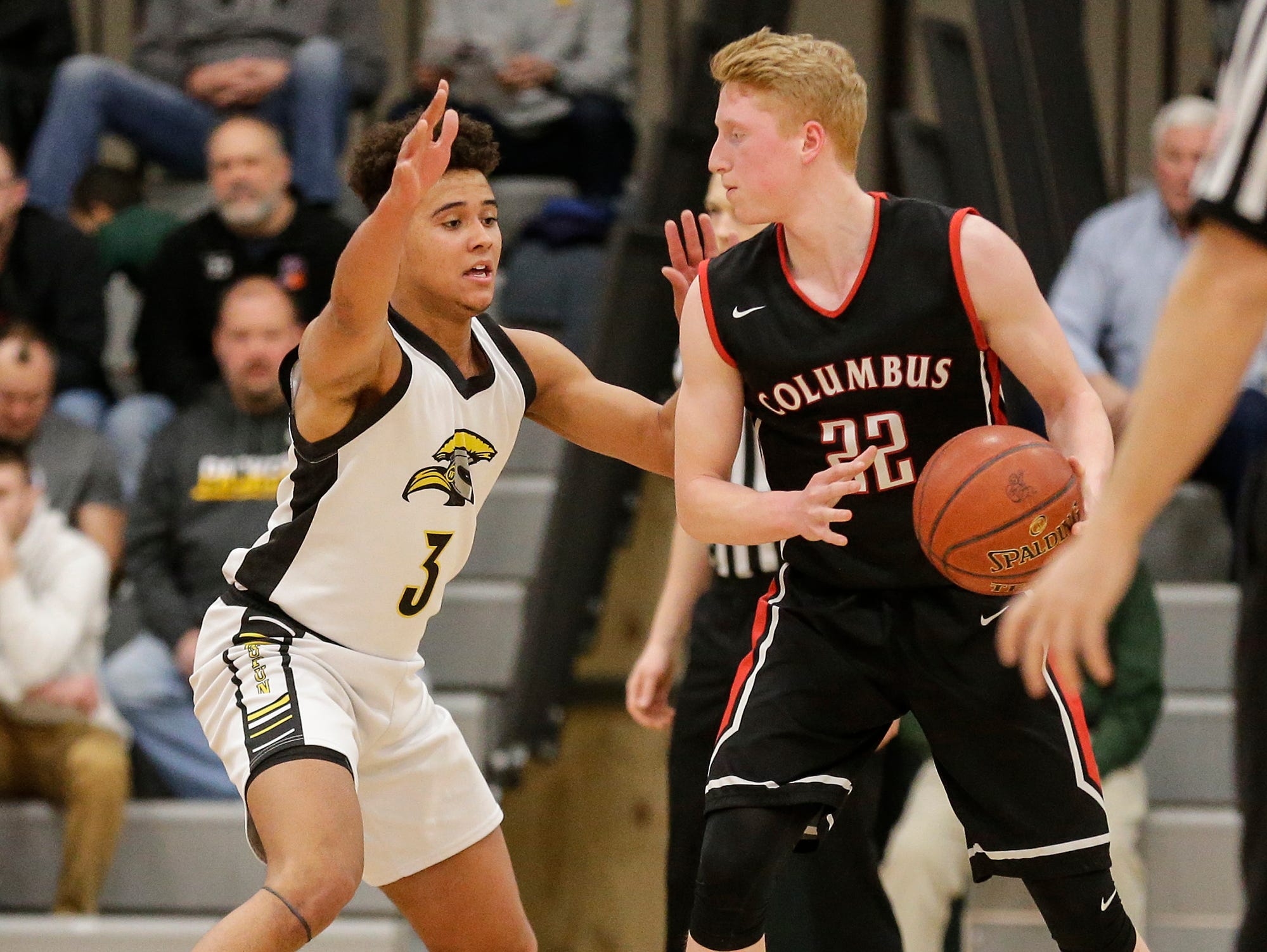 Waupun High School boys basketball's Quintin Winterfeldt plays defense against Columbus High School's Trent Casper during their WIAA division 3 sectional semi-final game Thursday, March 7, 2019 in Beaver Dam, Wis. Waupun won the game 79-36. Doug Raflik/USA TODAY NETWORK-Wisconsin