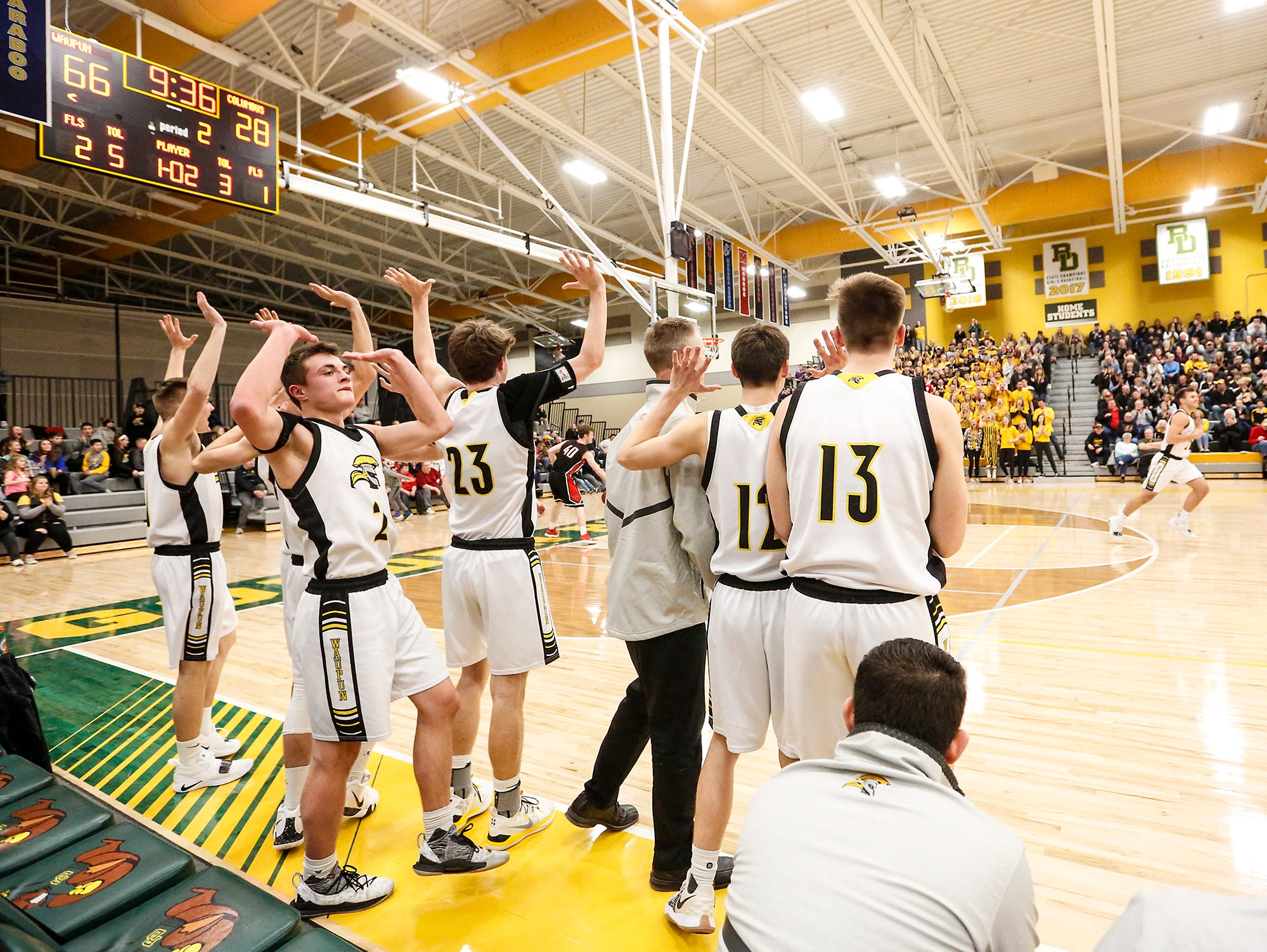 Waupun High School boys basketball players on the bench celebrate a basket against Columbus High School during their WIAA division 3 sectional semi-final game Thursday, March 7, 2019 in Beaver Dam, Wis. Waupun won the game 79-36. Doug Raflik/USA TODAY NETWORK-Wisconsin