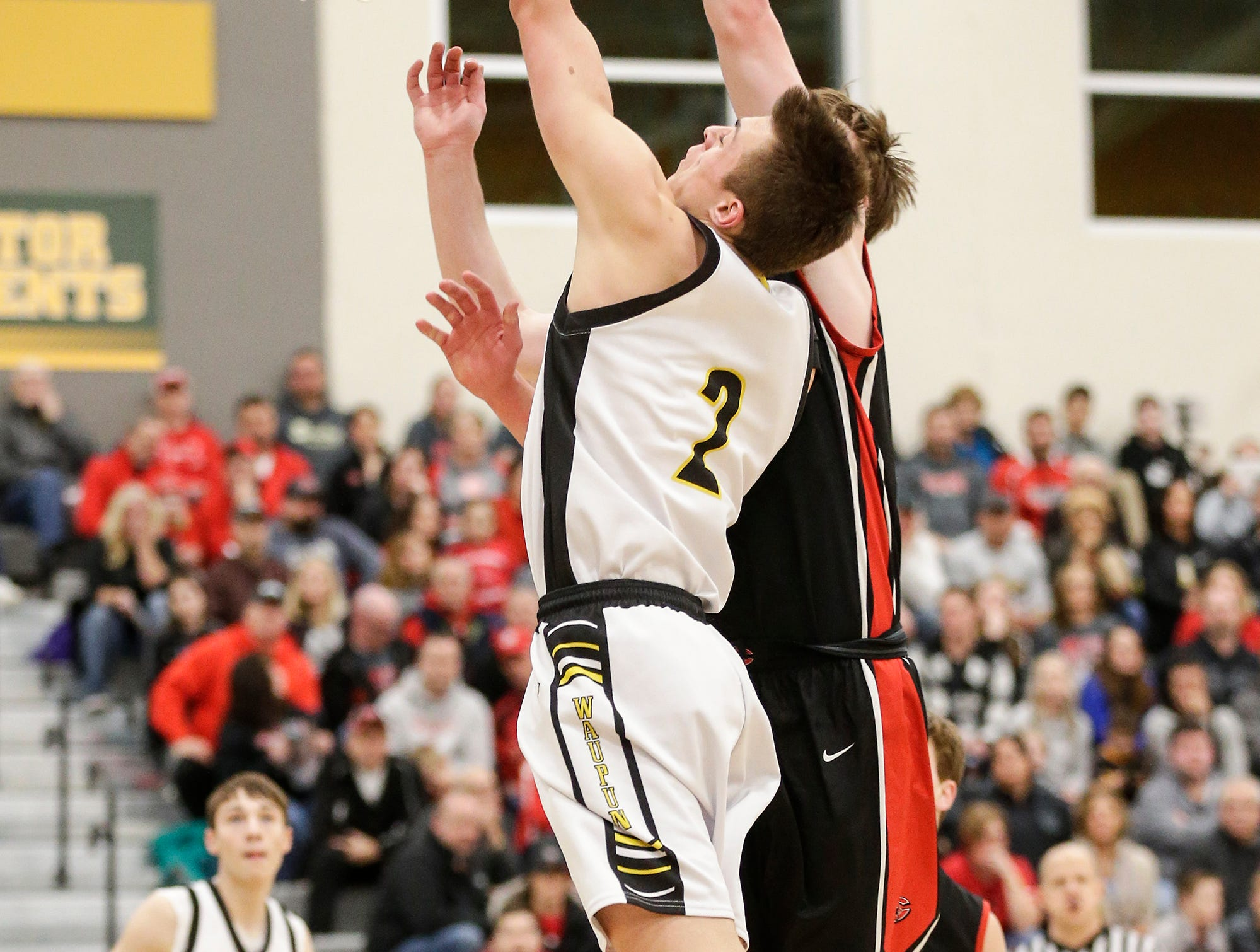 Waupun High School boys basketball's Trevor VandeZande goes up for a basket against Columbus High School's Ben Emler during their WIAA division 3 sectional semi-final game Thursday, March 7, 2019 in Beaver Dam, Wis. Waupun won the game 79-36. Doug Raflik/USA TODAY NETWORK-Wisconsin