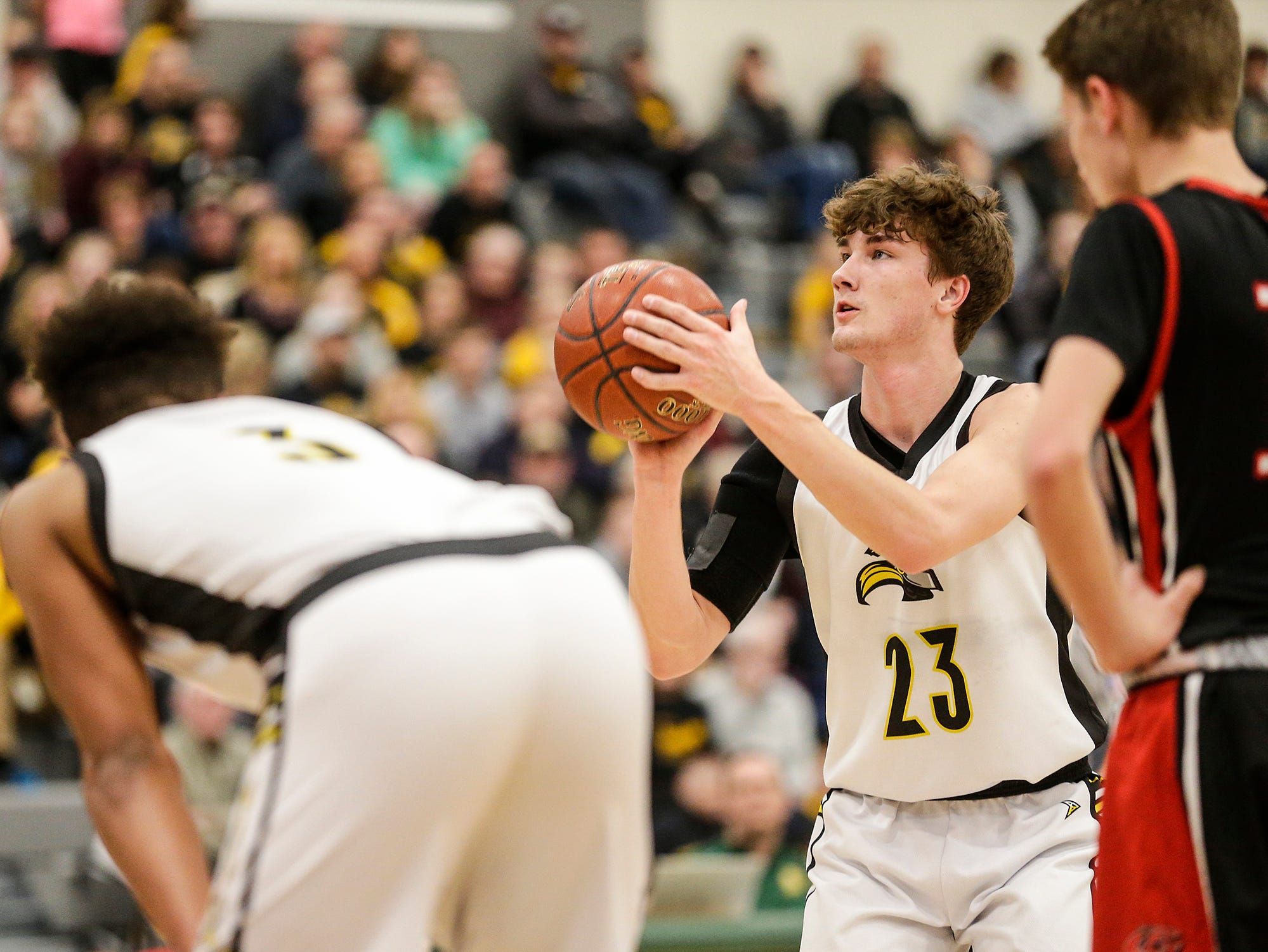 Waupun High School boys basketball's Reece Homan (23) attempts a free throw against Columbus High School during their WIAA division 3 sectional semi-final game Thursday, March 7, 2019 in Beaver Dam, Wis. Waupun won the game 79-36. Doug Raflik/USA TODAY NETWORK-Wisconsin