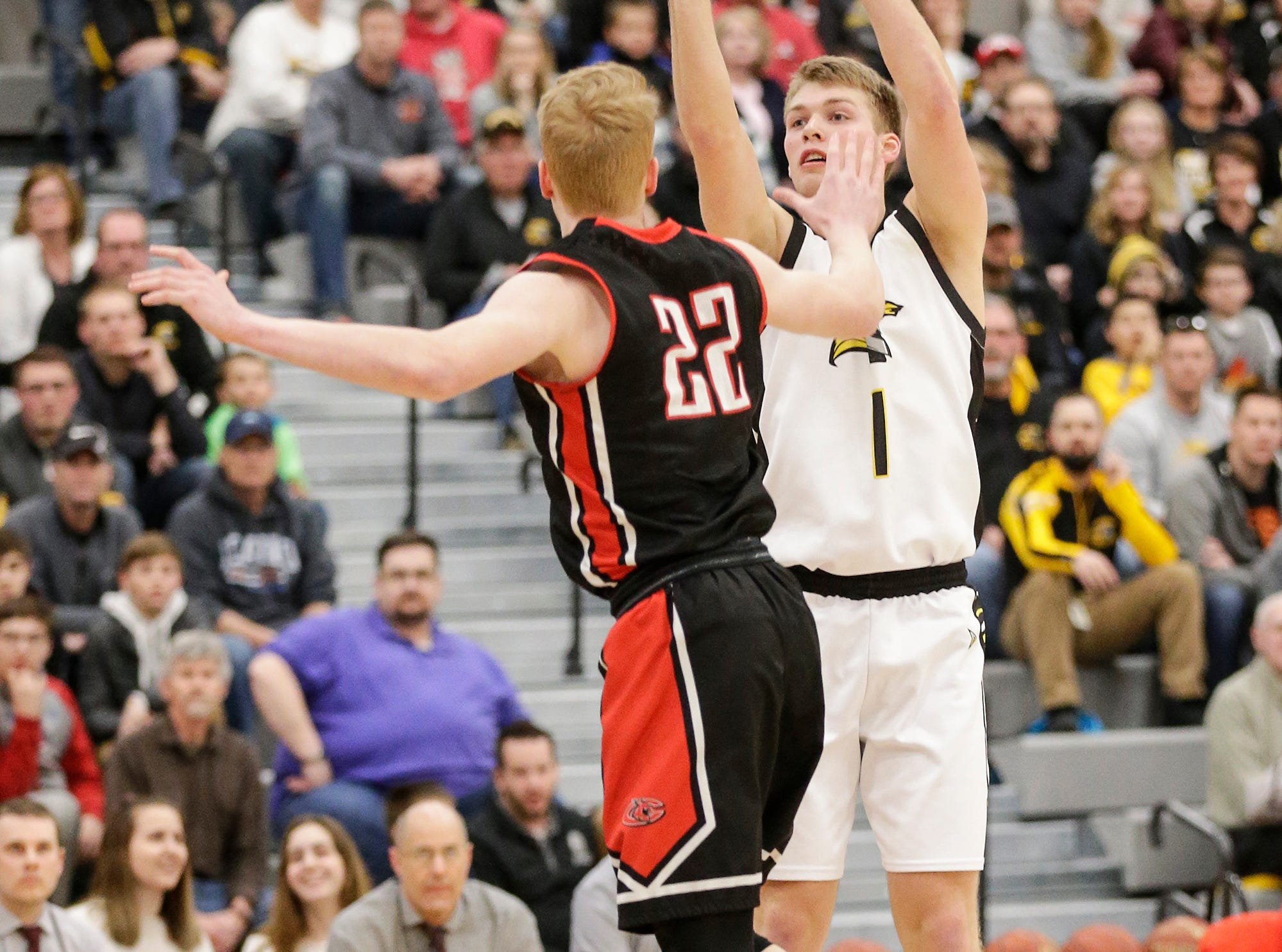 Waupun High School boys basketball's Marcus Domask (1) throws a three pointer against Columbus High School's Trent Casper (22) during their WIAA division 3 sectional semi-final game Thursday, March 7, 2019 in Beaver Dam, Wis. Waupun won the game 79-36. Doug Raflik/USA TODAY NETWORK-Wisconsin