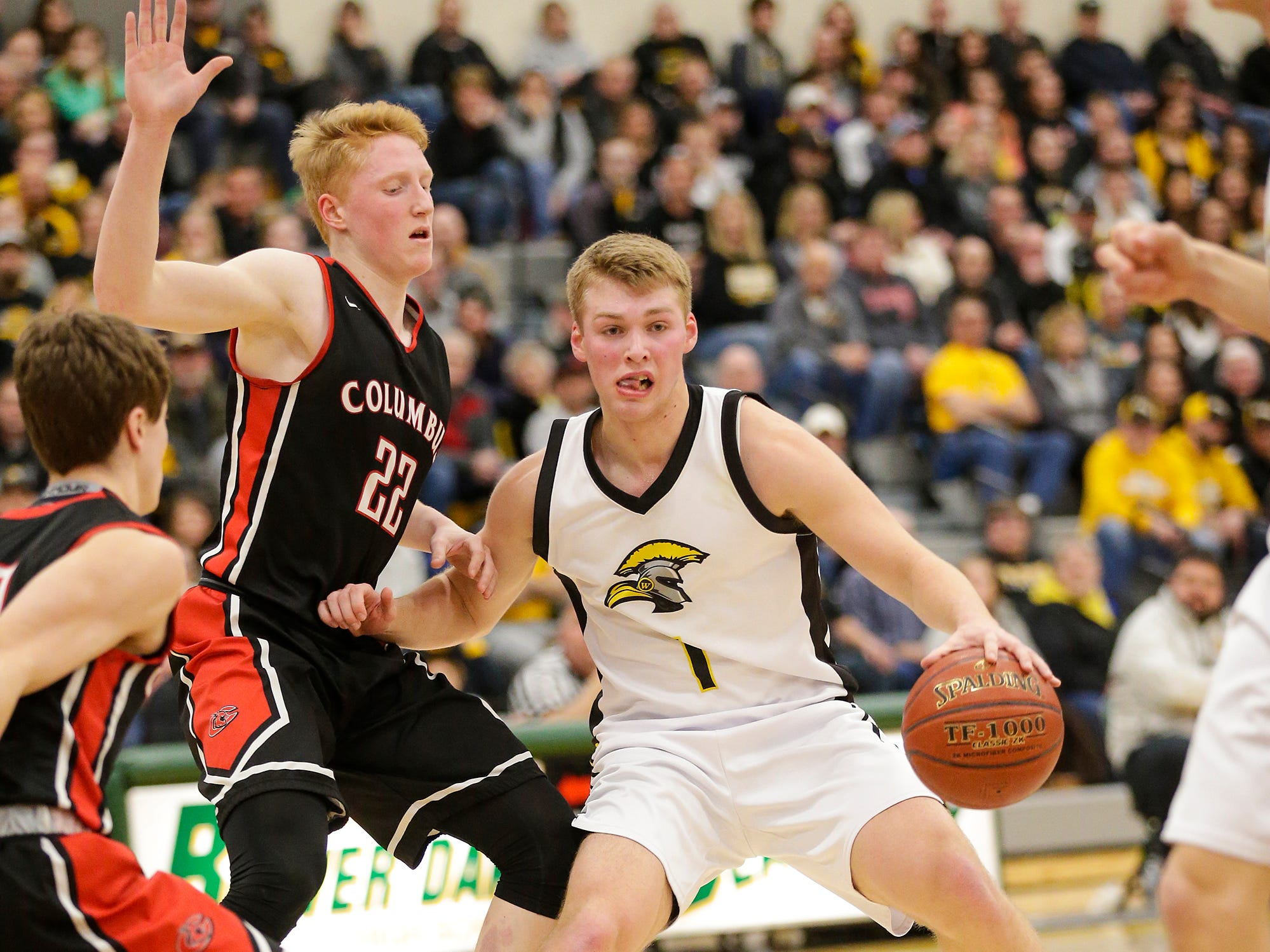 Waupun High School boys basketball's Marcus Domask (1) goes up against Columbus High School's Trent Casper on defense during their WIAA division 3 sectional semi-final game Thursday, March 7, 2019 in Beaver Dam, Wis. Waupun won the game 79-36. Doug Raflik/USA TODAY NETWORK-Wisconsin