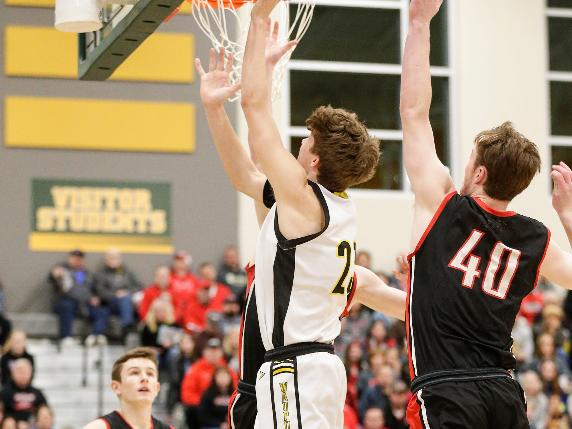 Waupun High School boys basketball's Trevor VandeZande goes up foa a basket against Columbus High School during their WIAA division 3 sectional semi-final game Thursday, March 7, 2019 in Beaver Dam, Wis. Waupun won the game 79-36. Doug Raflik/USA TODAY NETWORK-Wisconsin