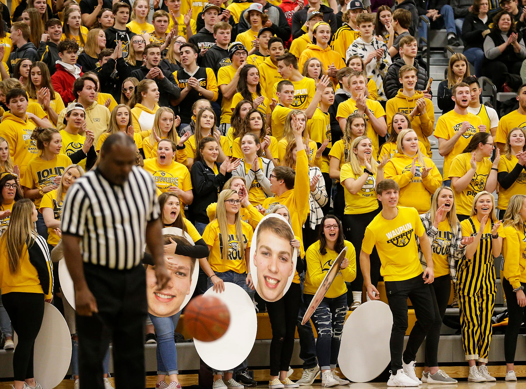 Waupun High School boys basketball's fans celebrate a basket against Columbus High School during their WIAA division 3 sectional semi-final game Thursday, March 7, 2019 in Beaver Dam, Wis. Waupun won the game 79-36. Doug Raflik/USA TODAY NETWORK-Wisconsin