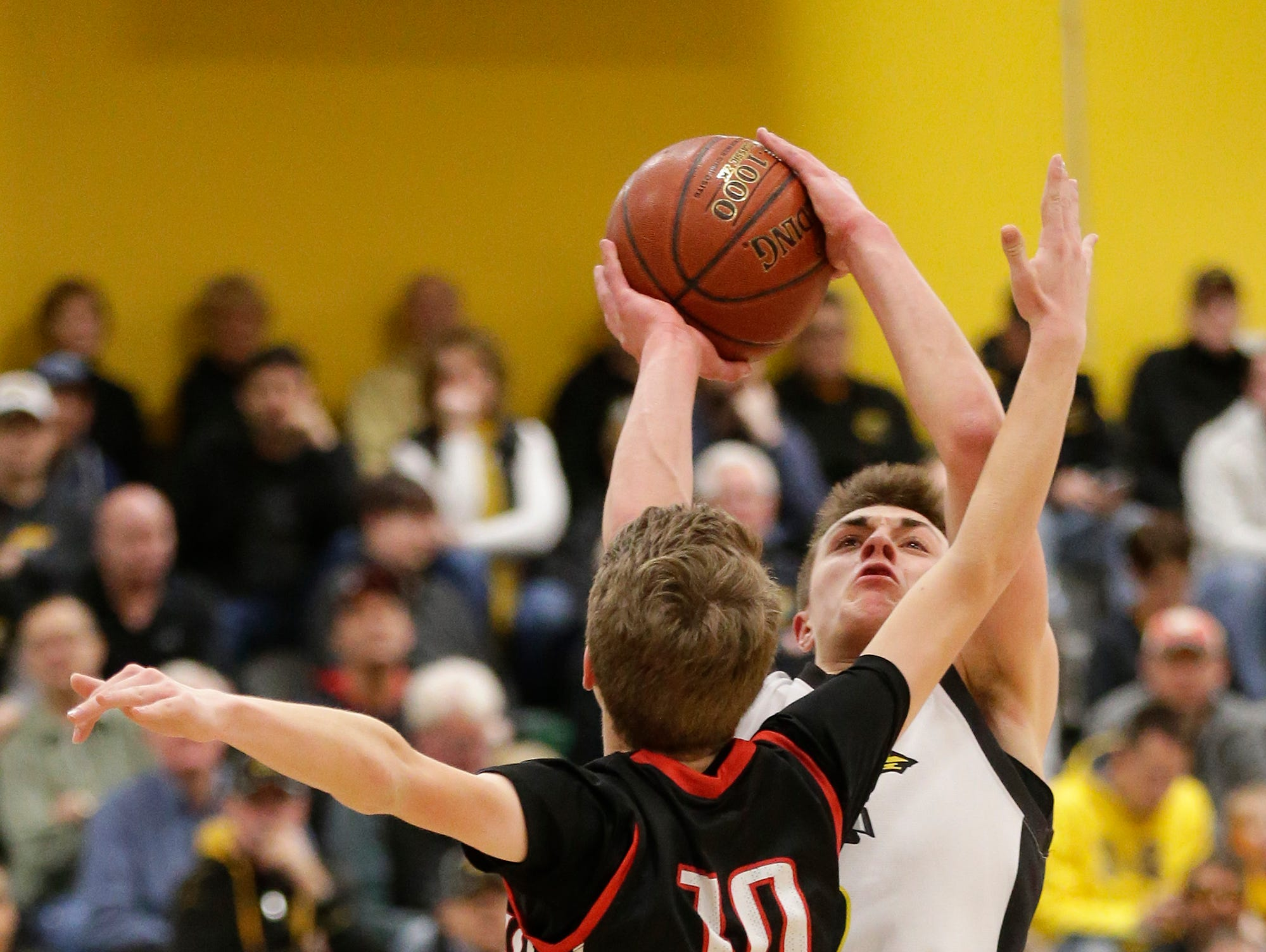 Waupun High School boys basketball's Trevor VandeZande goes up for a basket over Columbus High School's Adam Zahn during their WIAA division 3 sectional semi-final game Thursday, March 7, 2019 in Beaver Dam, Wis. Waupun won the game 79-36. Doug Raflik/USA TODAY NETWORK-Wisconsin