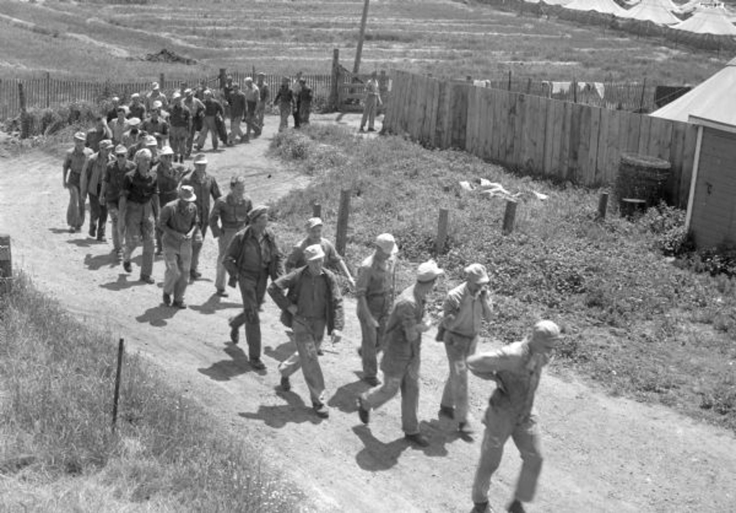 German POWs march to trucks in Columbus to go to work at canning company.