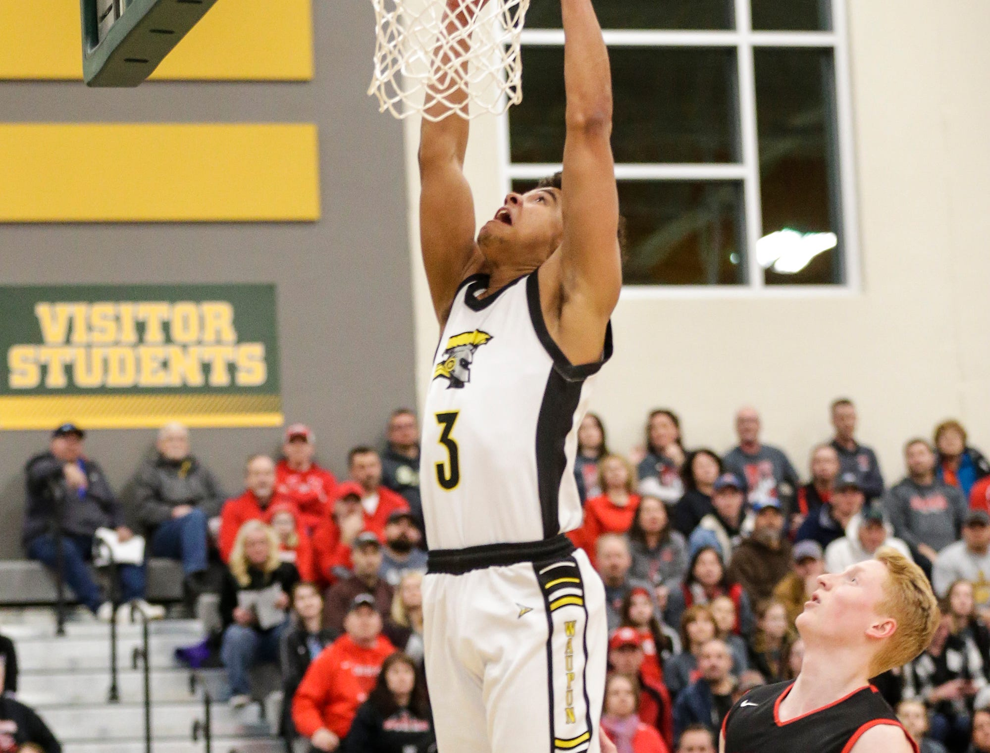 Waupun High School boys basketball's Quintin Winterfeldt (3) goes up for a basket against Columbus High School's Trent Casper (22) during their WIAA division 3 sectional semi-final game Thursday, March 7, 2019 in Beaver Dam, Wis. Waupun won the game 79-36. Doug Raflik/USA TODAY NETWORK-Wisconsin