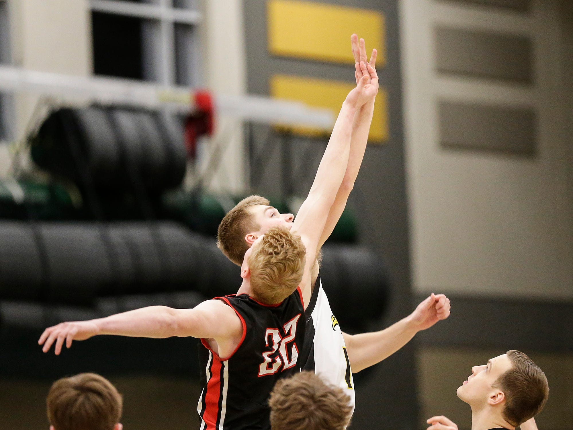 Waupun High School boys basketball's Marcus Domask (1) and Columbus High School's Trent Casper battle for the opening tip off during their WIAA division 3 sectional semi-final game Thursday, March 7, 2019 in Beaver Dam, Wis. Waupun won the game 79-36. Doug Raflik/USA TODAY NETWORK-Wisconsin