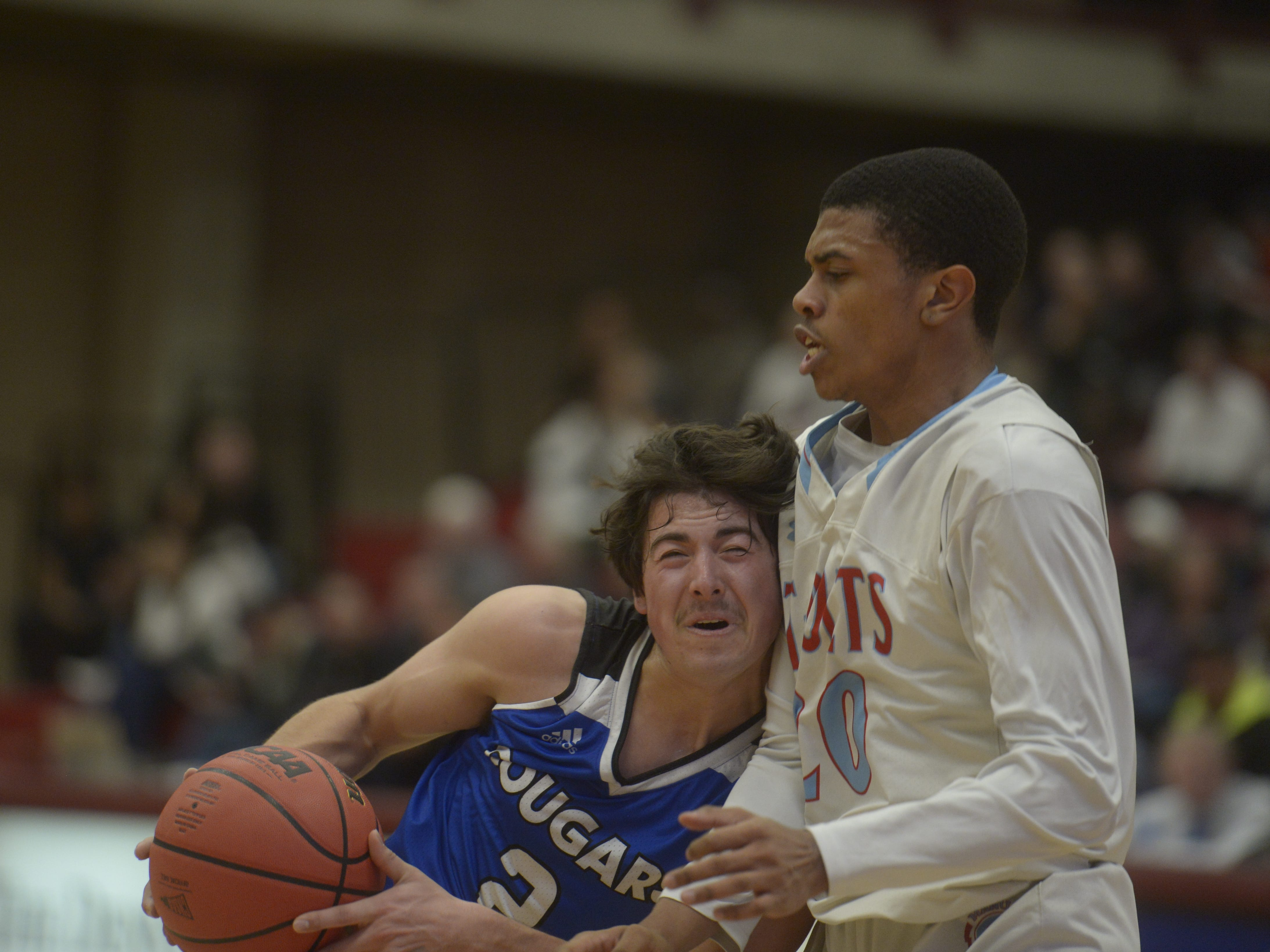 Resurrection Christian guard Jackson Romero tries to get past a defender during a Class 3A quarterfinals game against Manual at the University of Denver on Thursday, March 7, 2019.