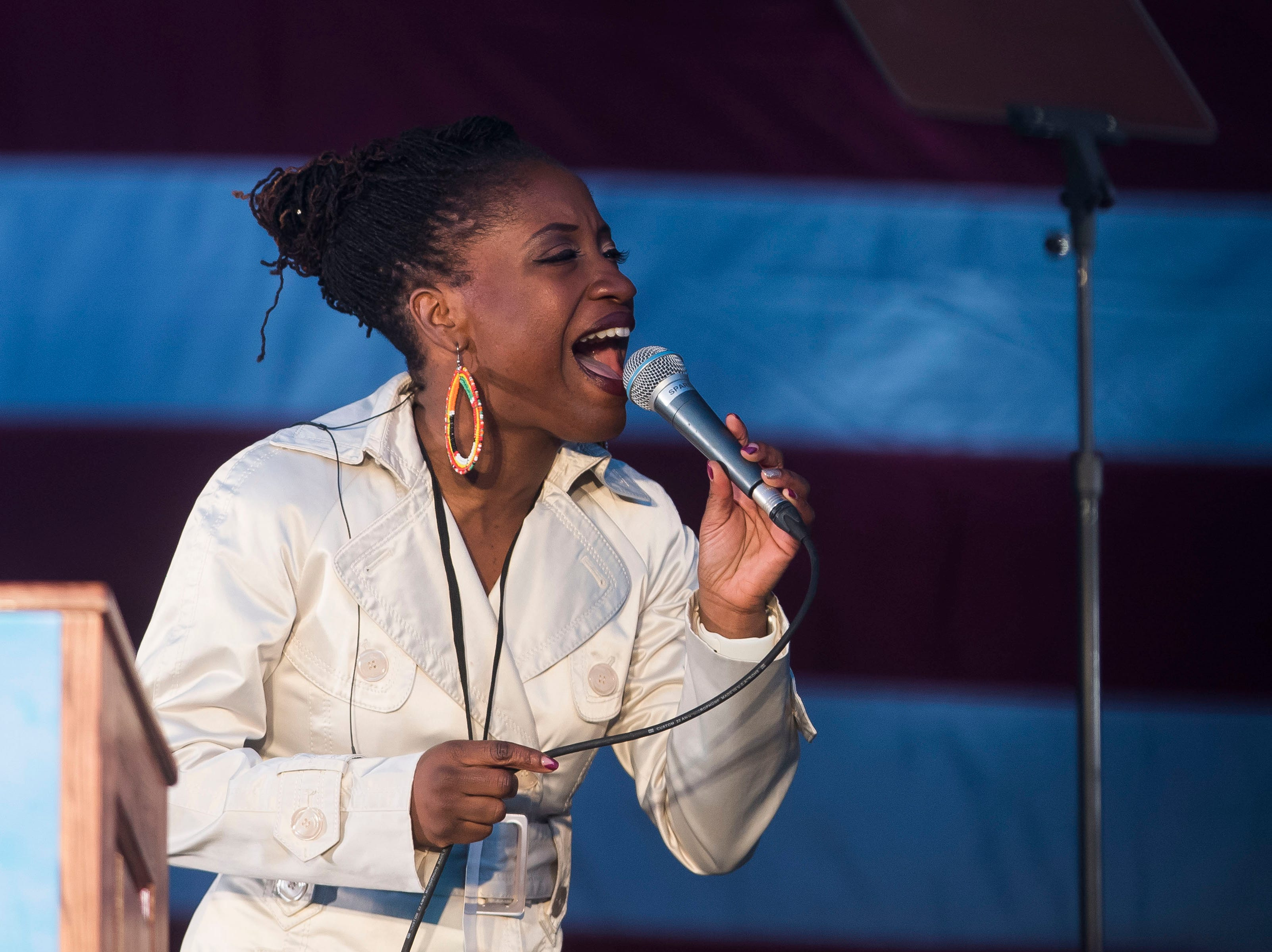 Denver resident and soul singer SuCh performs at the John Hickenlooper presidential campaign kick-off rally on Thursday, March 7, 2019, at the Greek Ampitheatre in Civic Center Park in Denver, Colo.