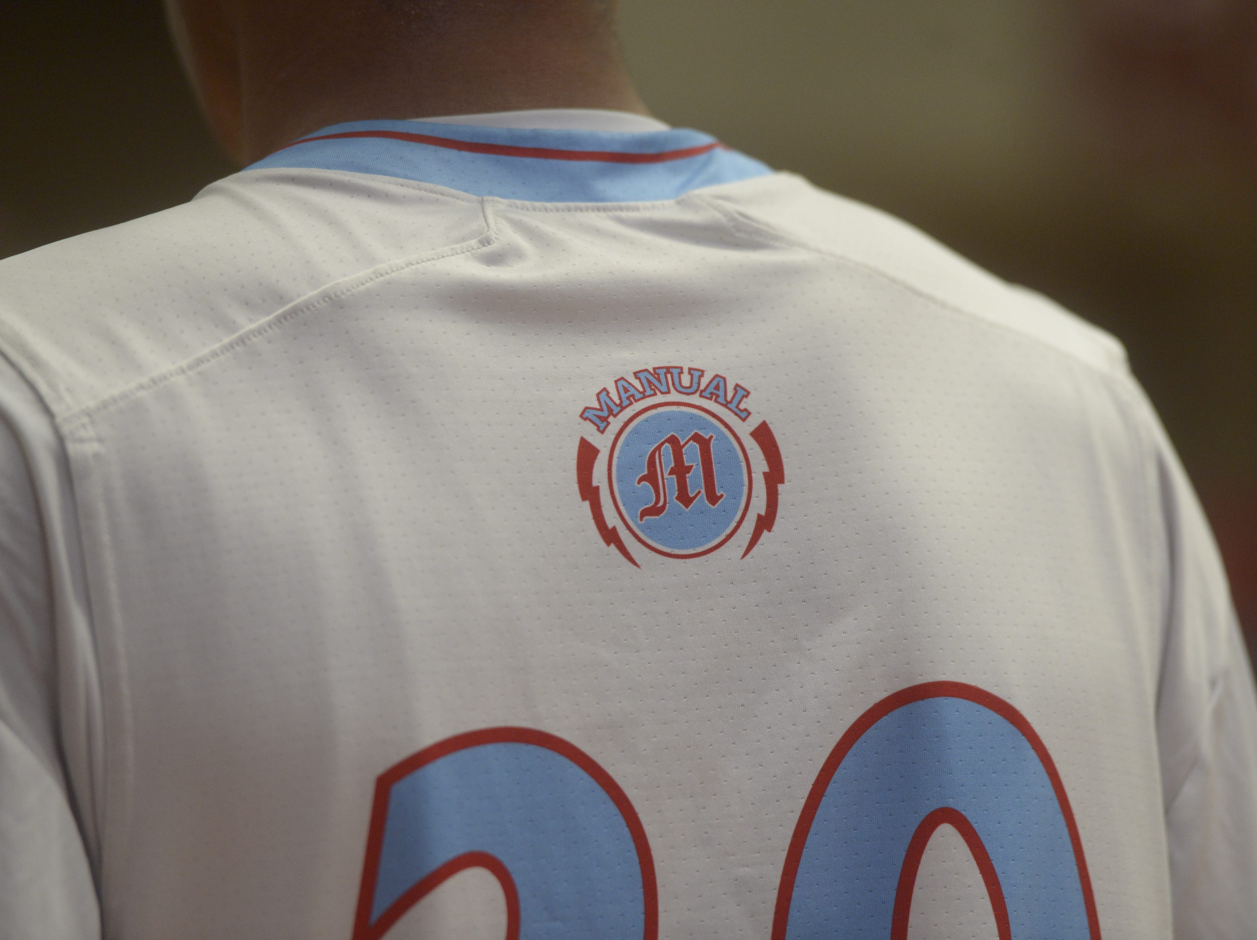 The Manual logo on the back of a jersey during a Class 3A quarterfinals game at the University of Denver on Thursday, March 7, 2019.