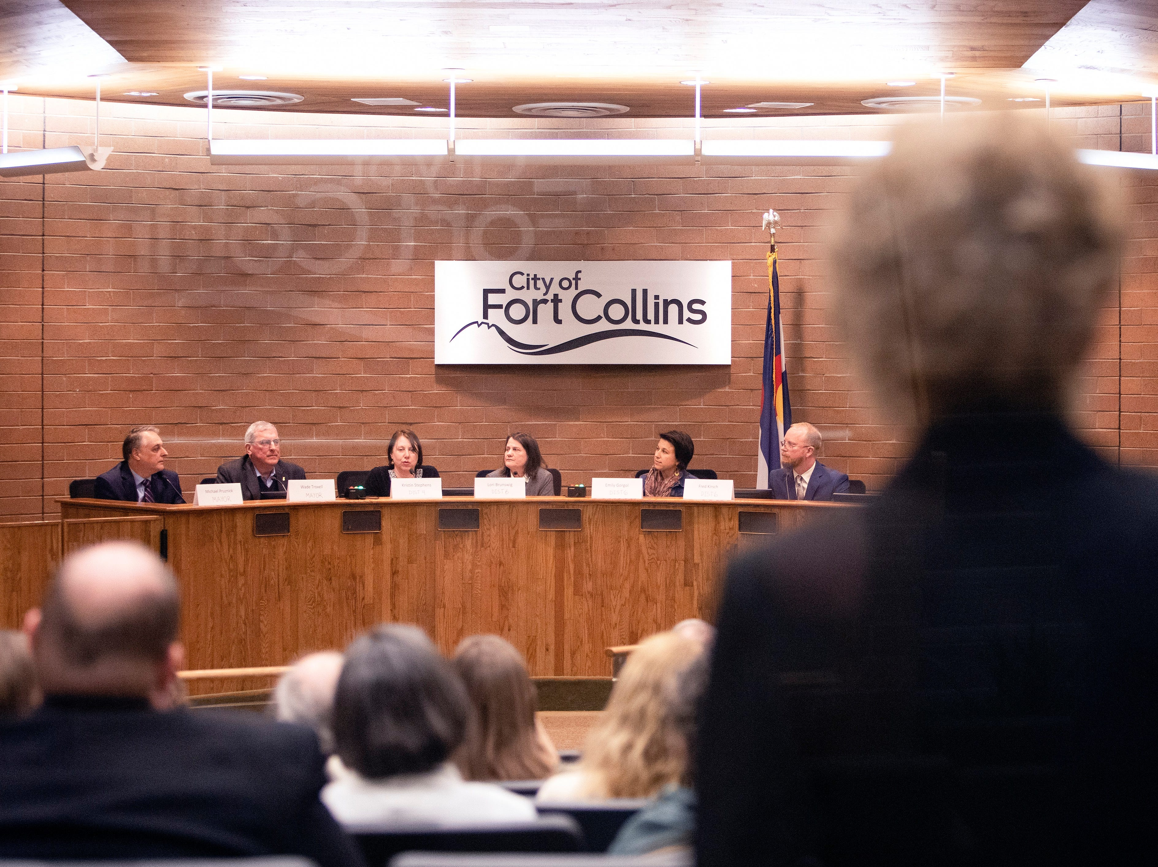 Community members  watch as candidates for the Fort Collins City Council election answer questions in a forum hosted by The League of Women Voters of Larimer County at City Hall on March 6.