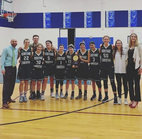 The Heritage Christian girls basketball team, shown celebrating a regional championship, made the 2A state tournament with eight players.