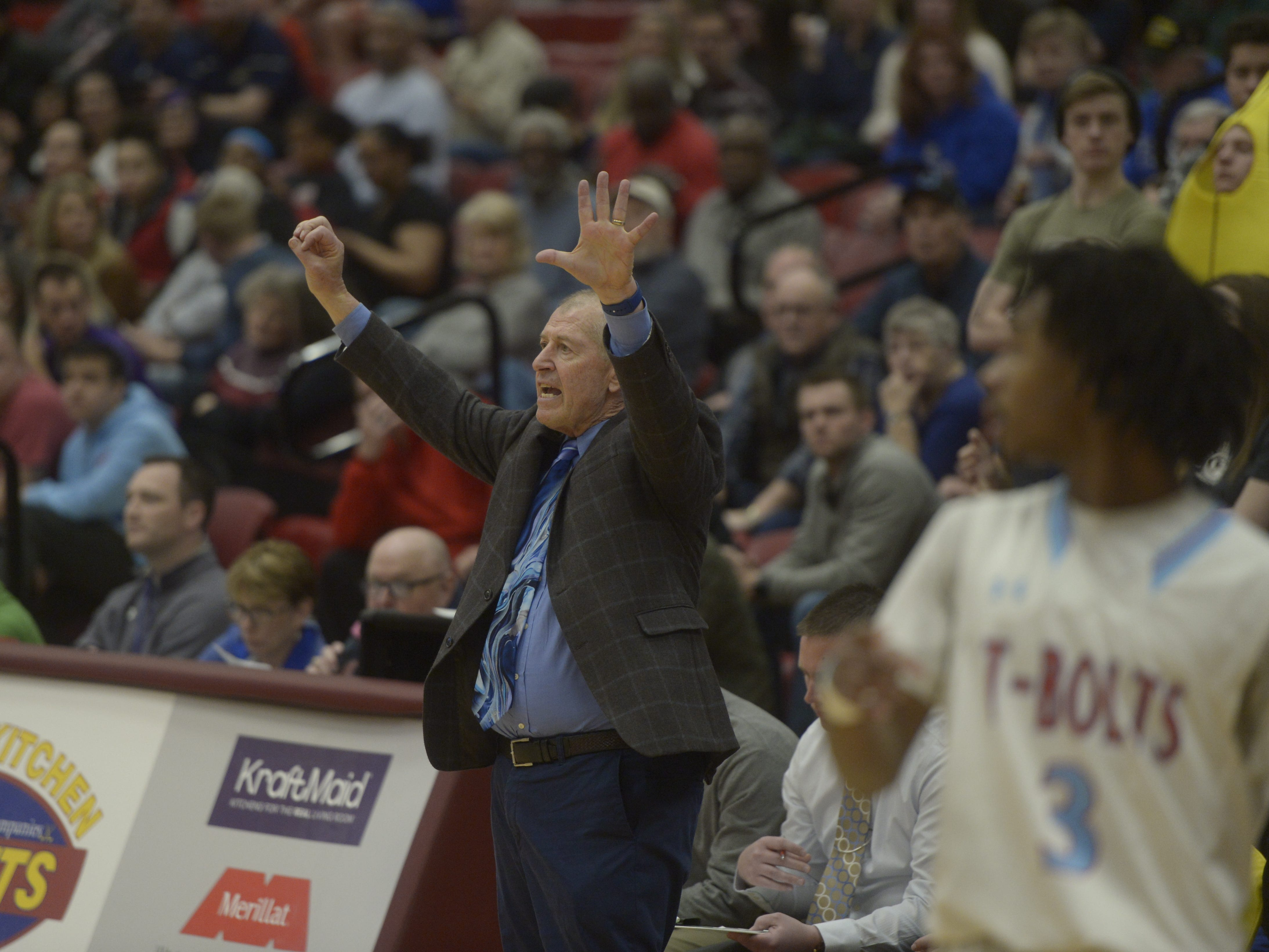 Resurrection Christian basketball coach Bruce Dick gives instructions during a Class 3A quarterfinals game against Manual at the University of Denver on Thursday, March 7, 2019.
