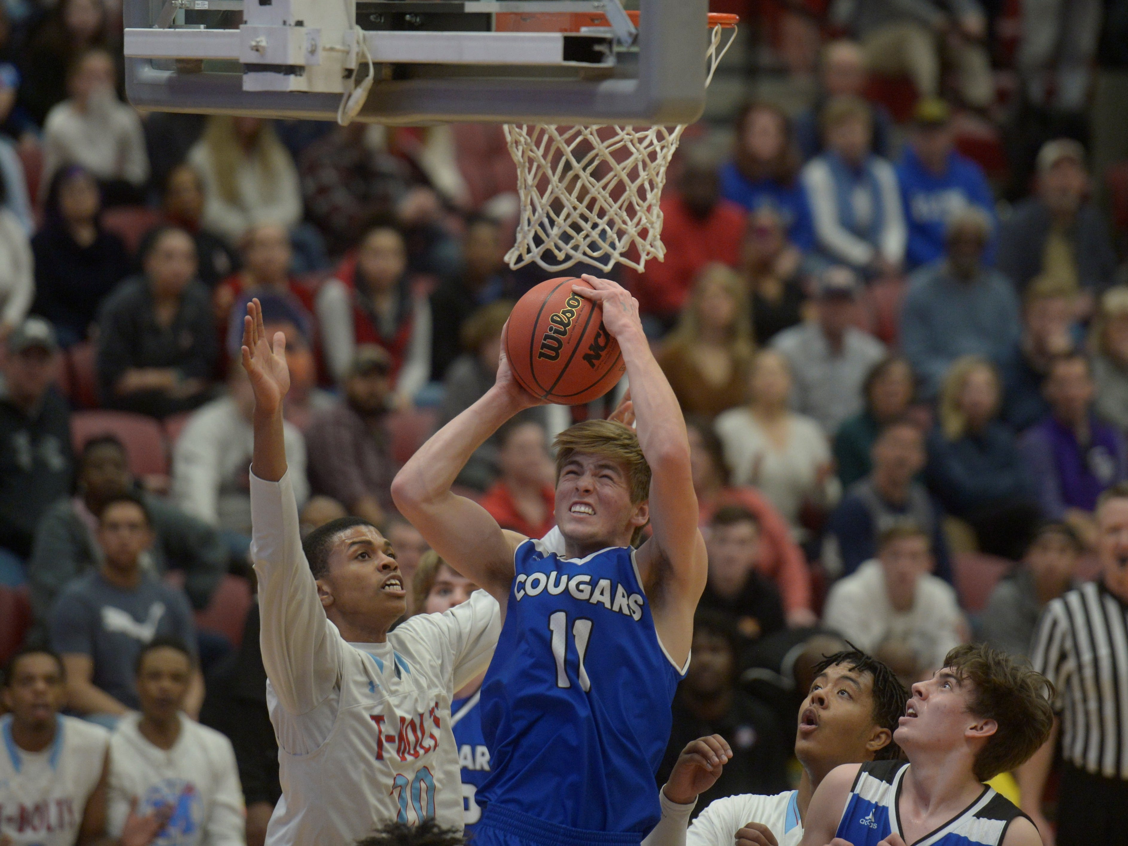 Resurrection Christian forward Reade Lindgren grabs a rebound during a Class 3A quarterfinals game against Manual at the University of Denver on Thursday, March 7, 2019.