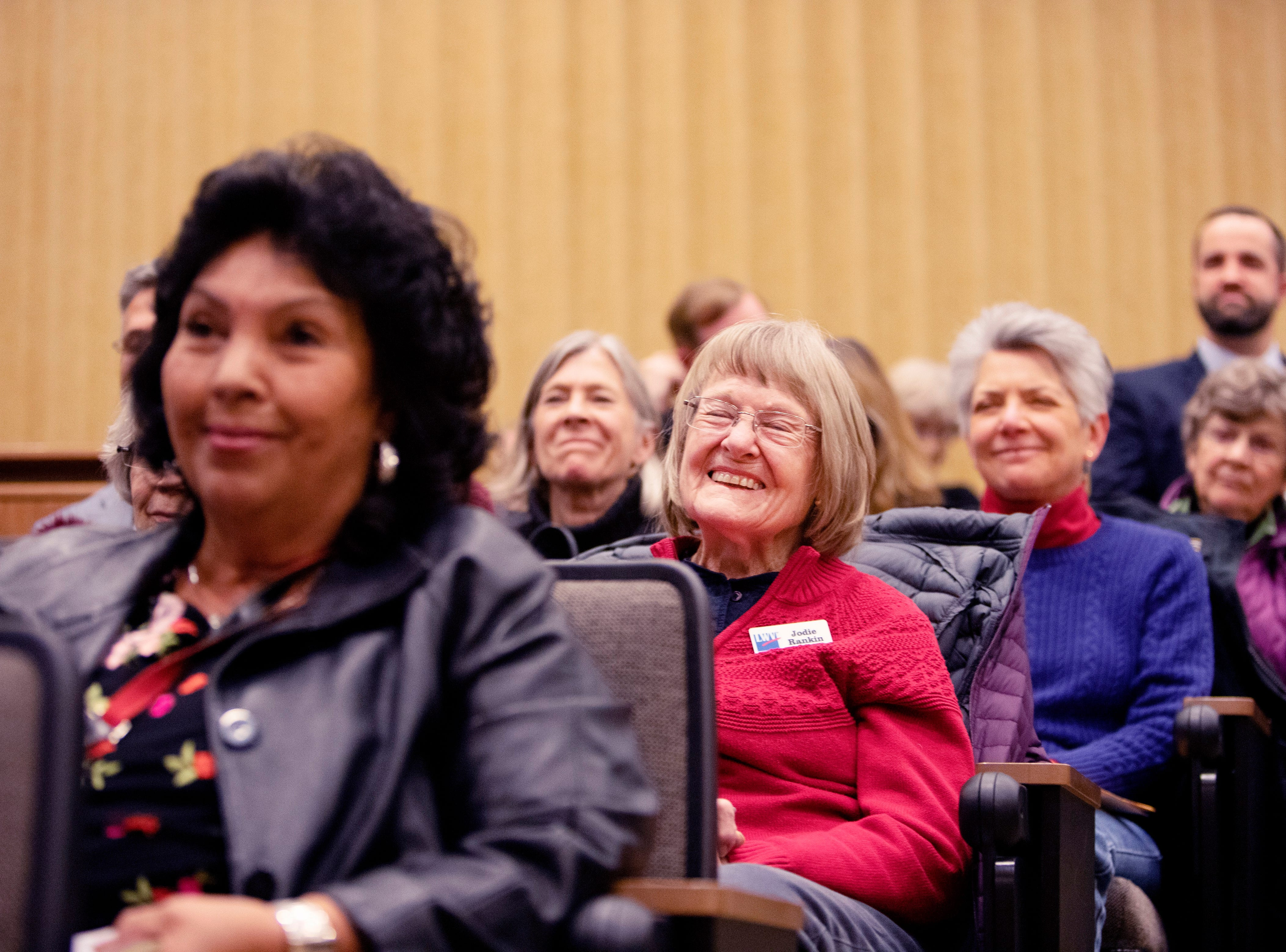 League of Women Voters member Jodie Rankin, in red, reacts to a comment made by a candidate during the forum at City Hall on March 6.