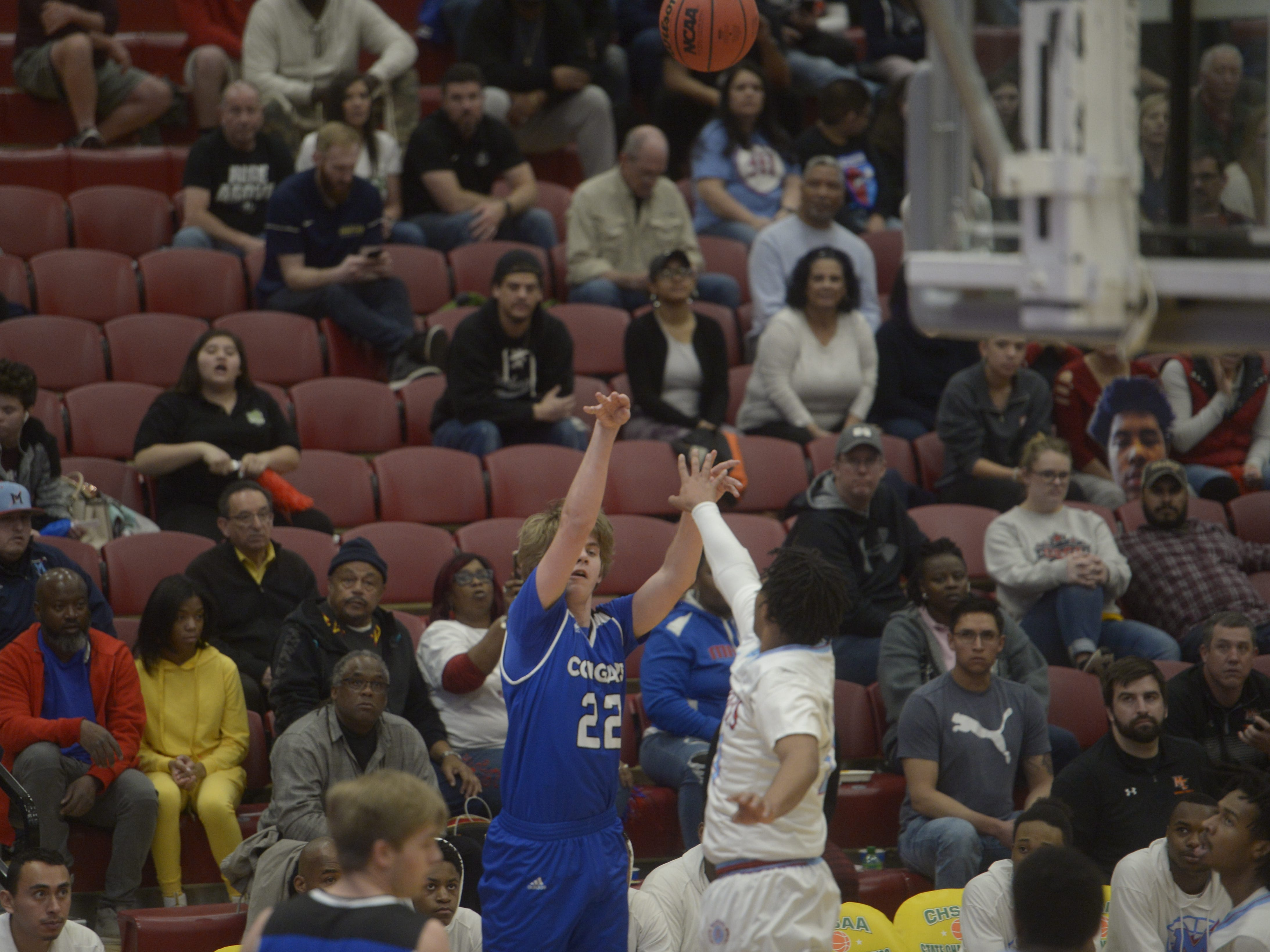 Resurrection Christian guard Sparky Morris fires a 3-pointer during a Class 3A quarterfinals game against Manual at the University of Denver on Thursday, March 7, 2019.