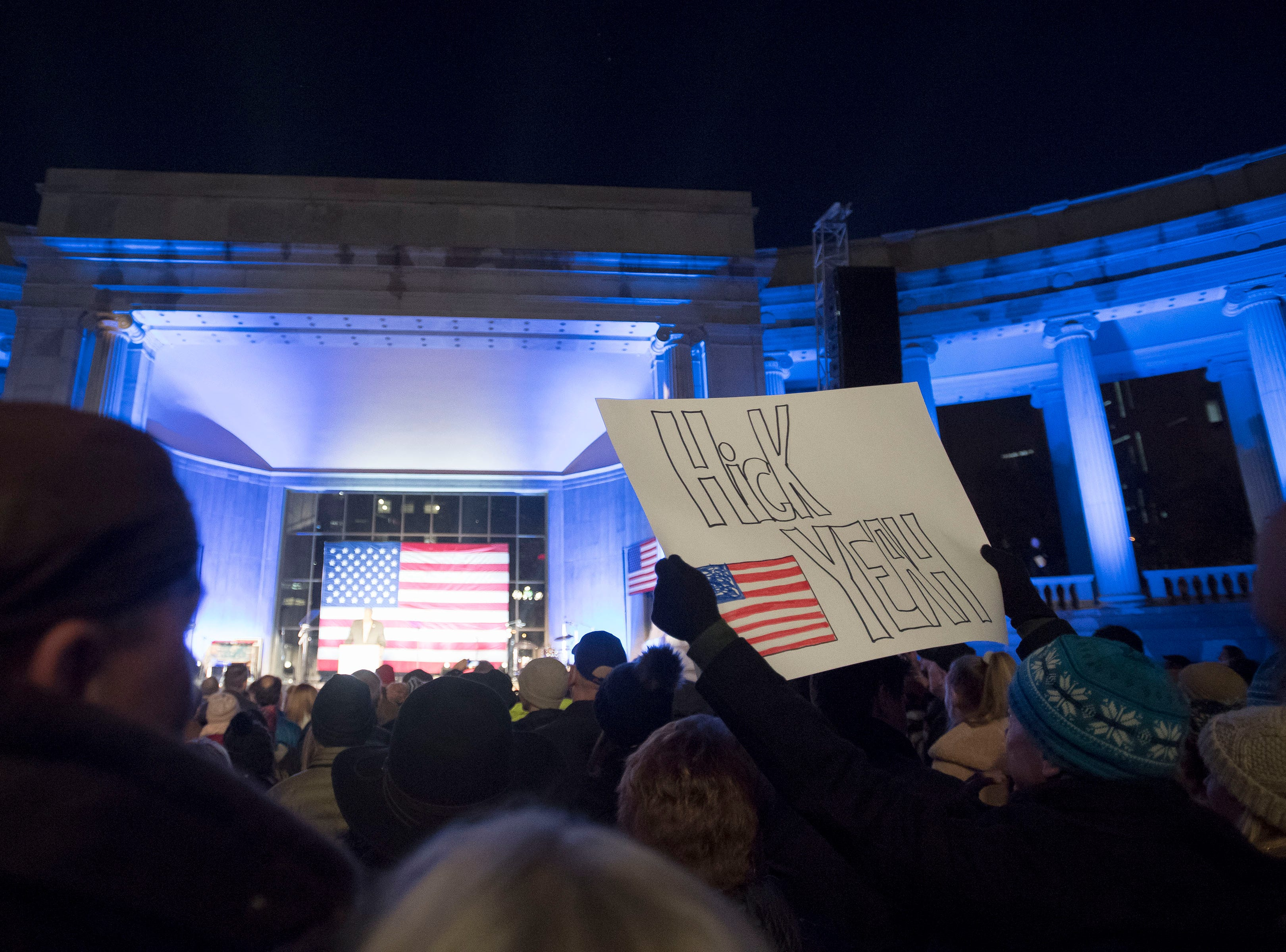 A rally participant holds up a sign during the John Hickenlooper presidential campaign kick-off rally on Thursday, March 7, 2019, at the Greek Ampitheatre in Civic Center Park in Denver, Colo.